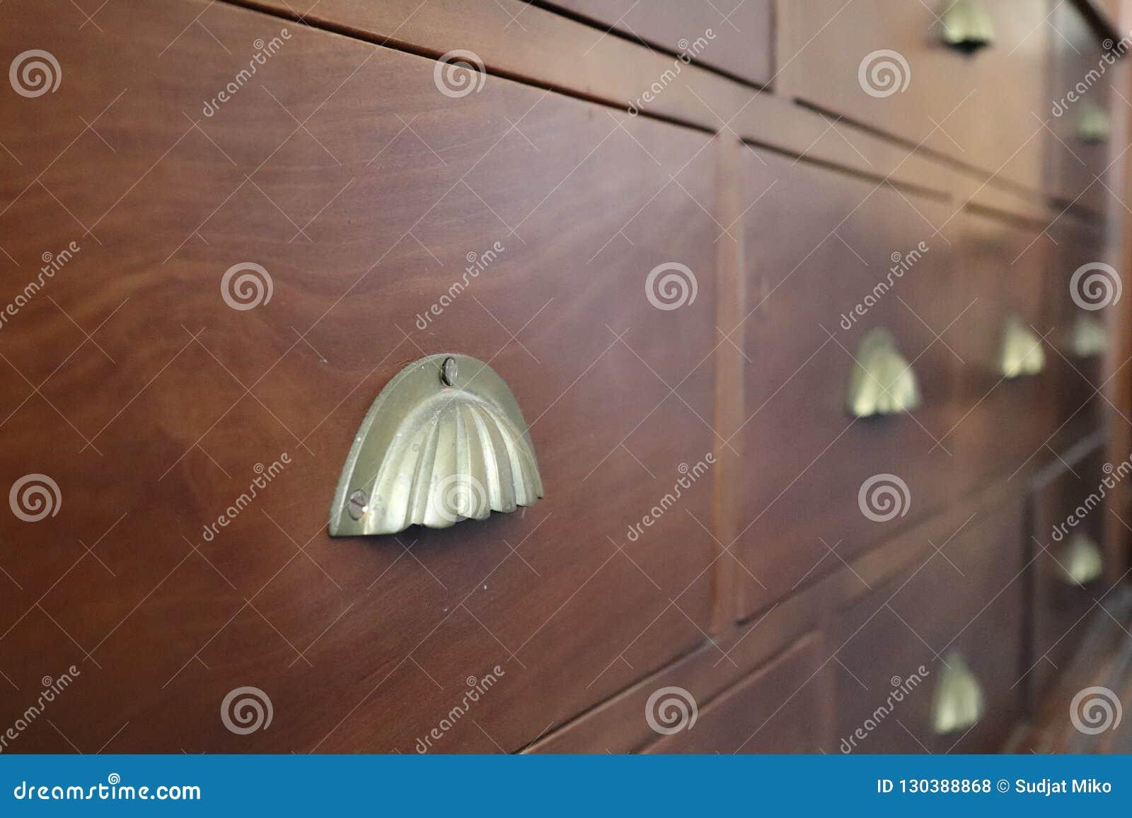Antique clothes drawer, unique drawer handles, wood furniture.