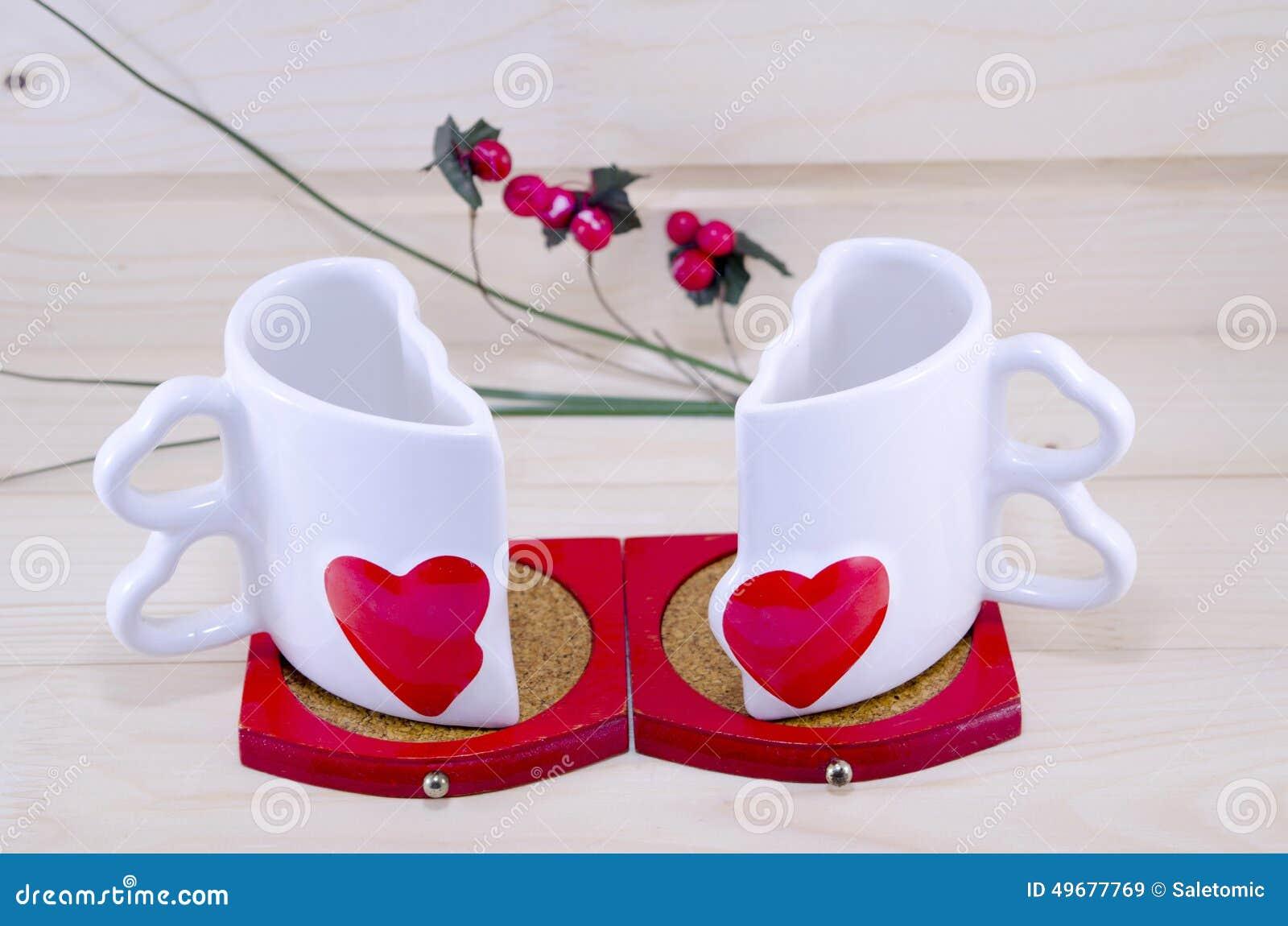 Unique Heart Shaped Coffee Mug Split Apart Stock Photo