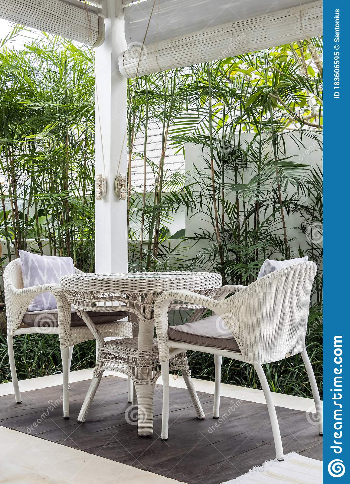 Unique Patio Area With Wooden Furniture Surrounded By A Garden Stock Image Image Of Flower Green 183606595