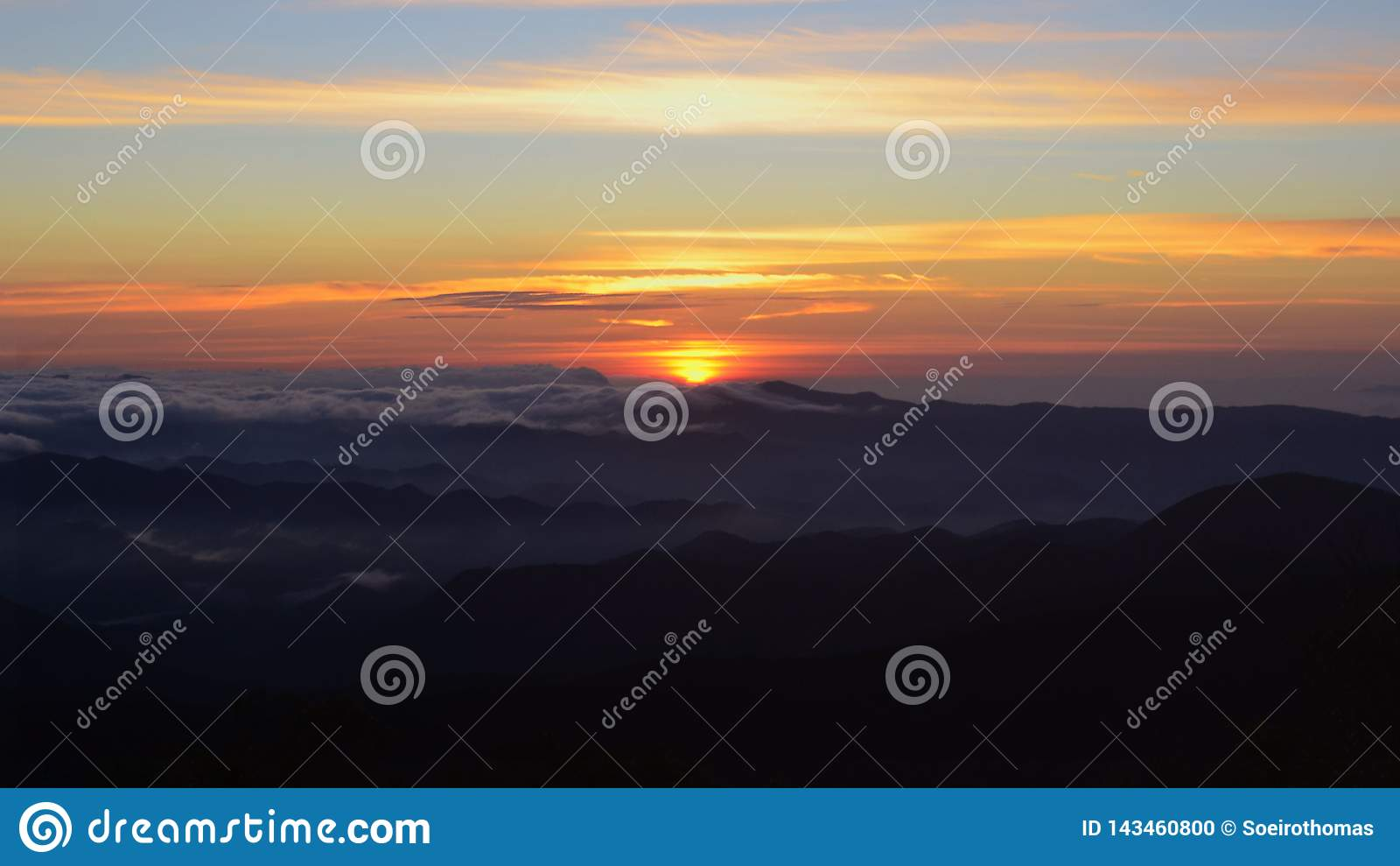 Unique Sunset In The Mountains Covered With Clouds Stock