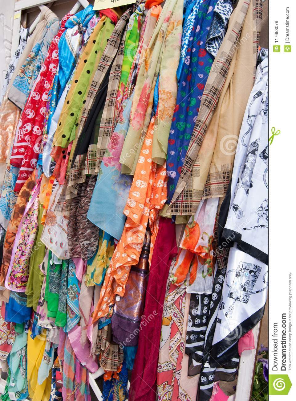 Many brightly colored scarves hung as souvenirs