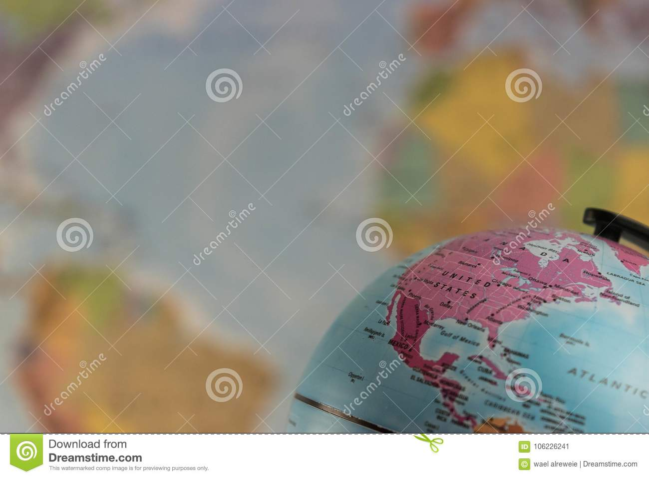 Us Map Globe.The United States Of America On The Map Globe With Blurred Map As