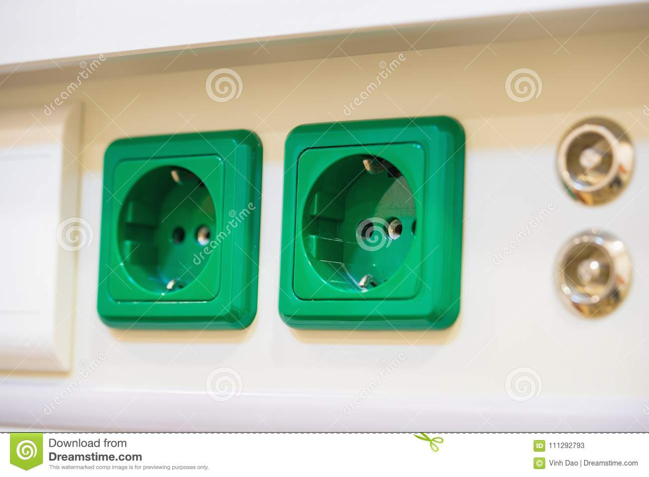 Universal electrical sockets on bedhead in hospital