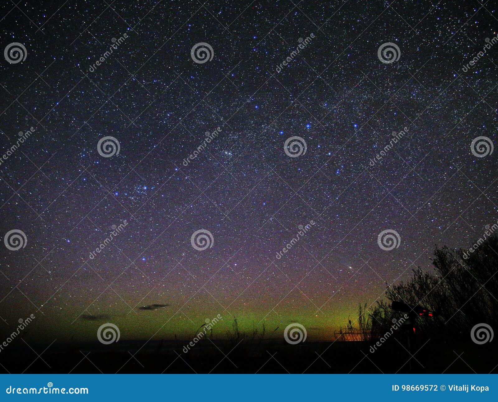 Night sky stars and polar lights Perseus constellation Andromeda Galaxy