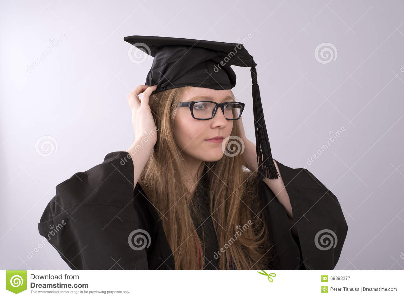 University Graduate Wearing Cap And Gown Stock Image - Image of ...