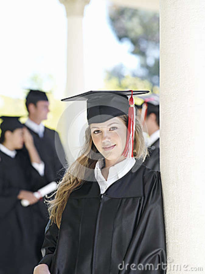 University Student In Graduation Gown And Mortar Board, Smiling ...