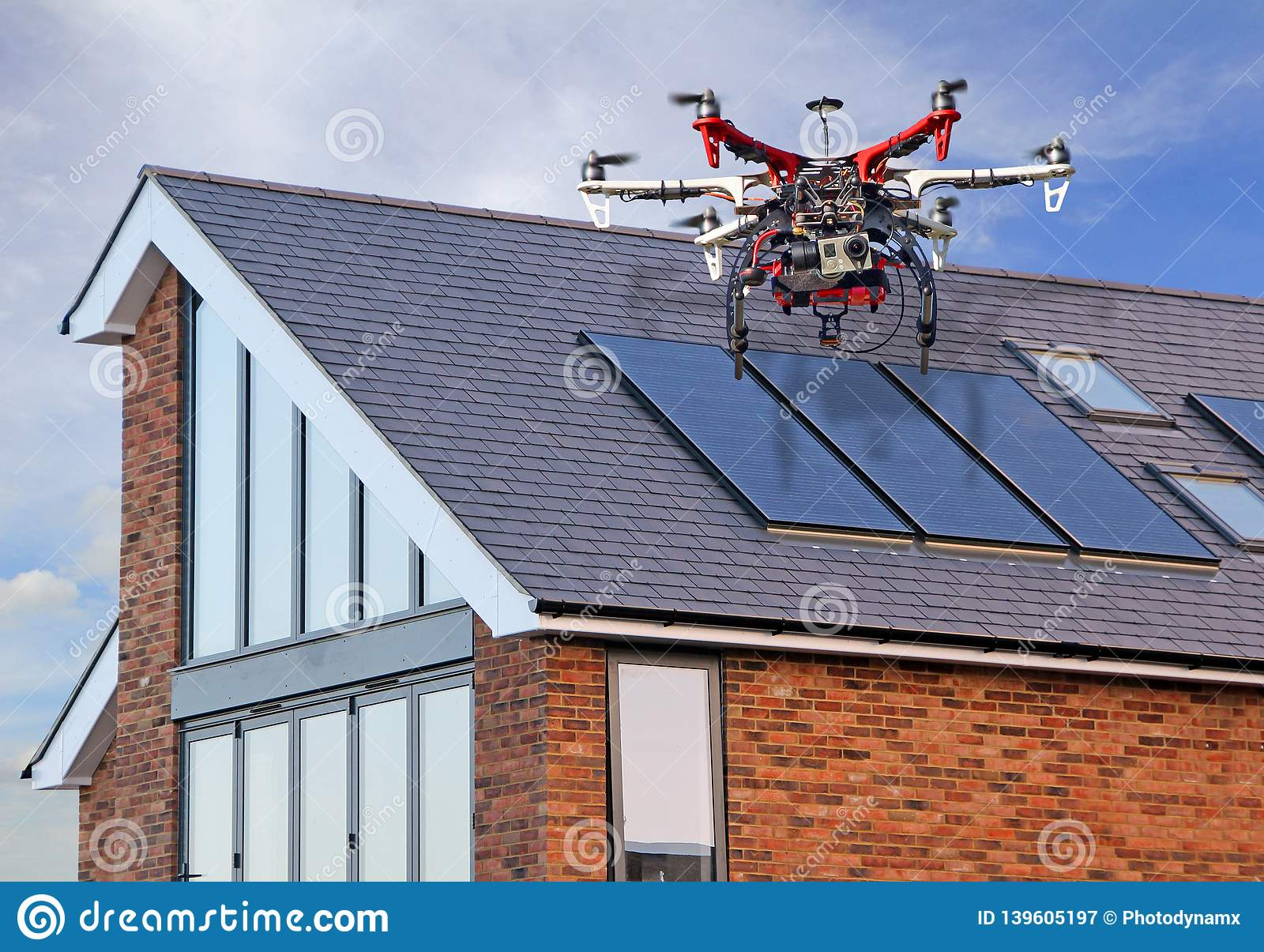 Unmanned aerial vehicle drone surveying home roof repairs