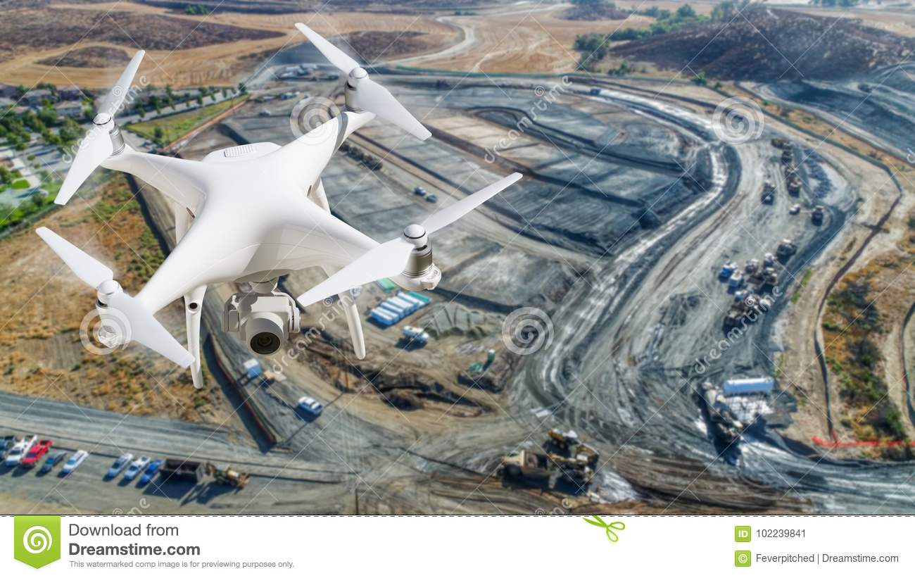 Unmanned Aircraft System UAV Quadcopter Drone In The Air Over