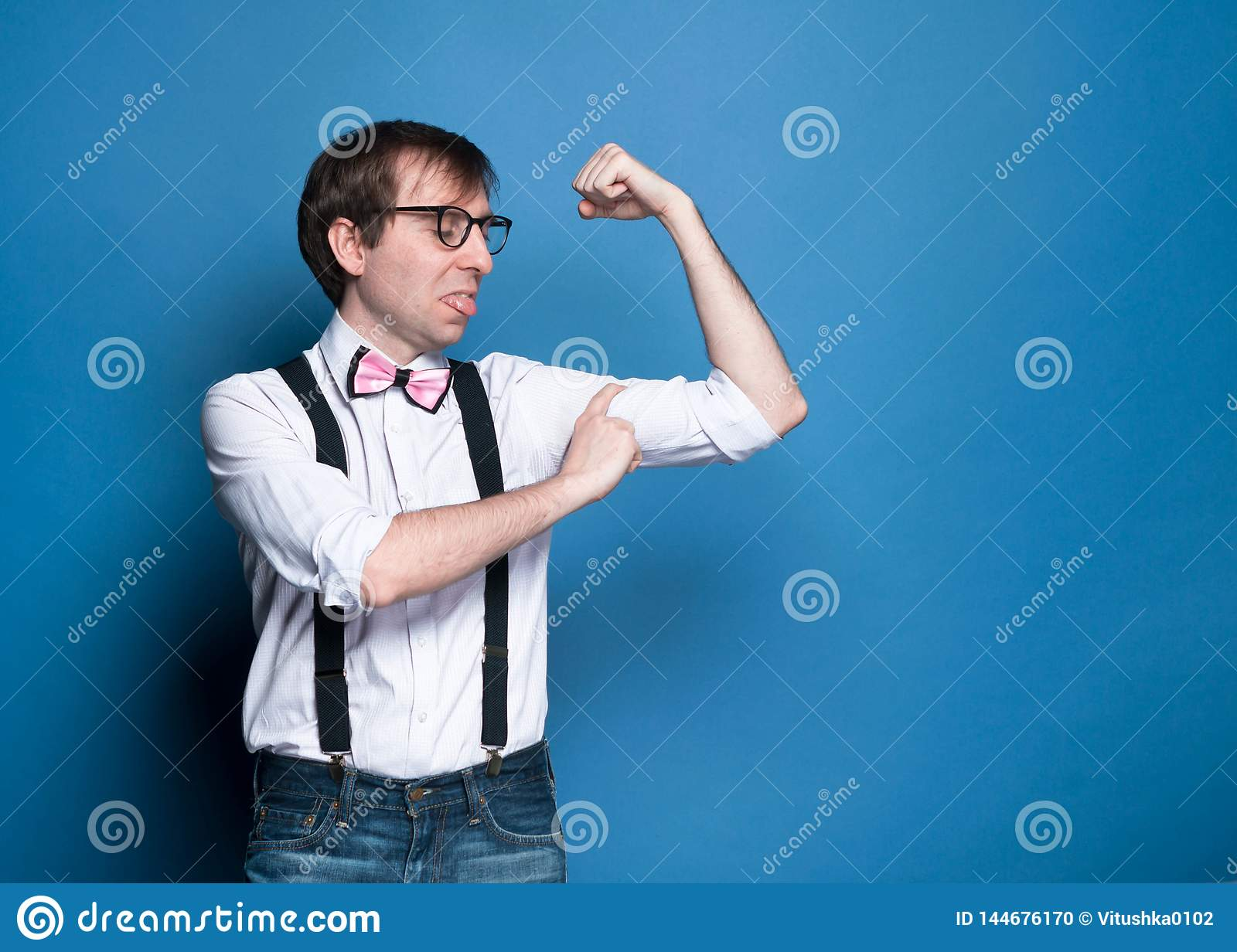Unny disappointed thin man measuring biceps with finger