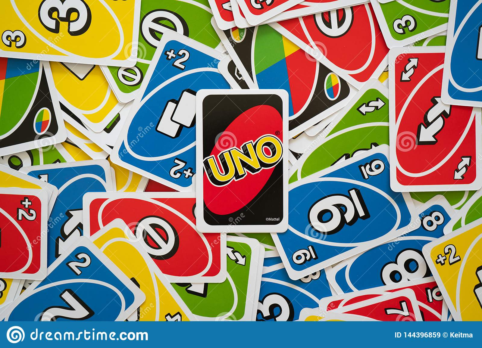 Uno Game Cards Scattered All Over The Frame And One Card