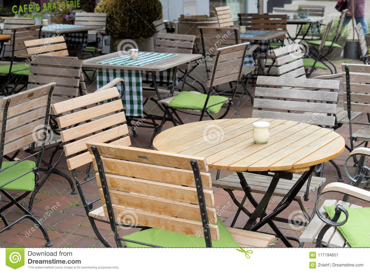 Unoccupied Chairs And Tables In A Garden Restaurant With Table