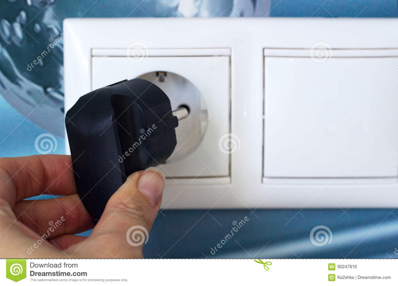 Unplug or plugged in concept,hand holding electric plug