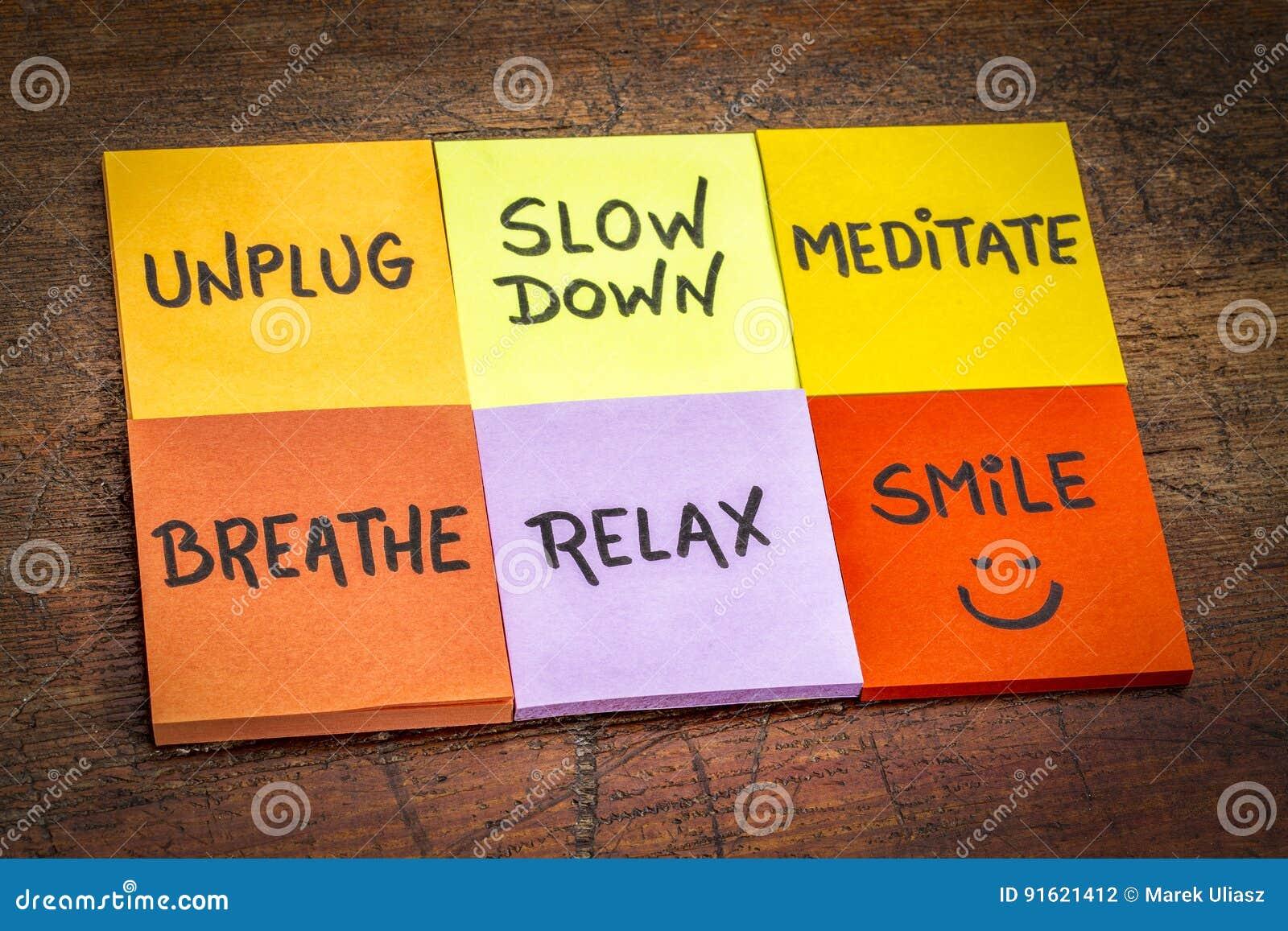 Unplug, slow down, meditate, breathe, relax, smile concept