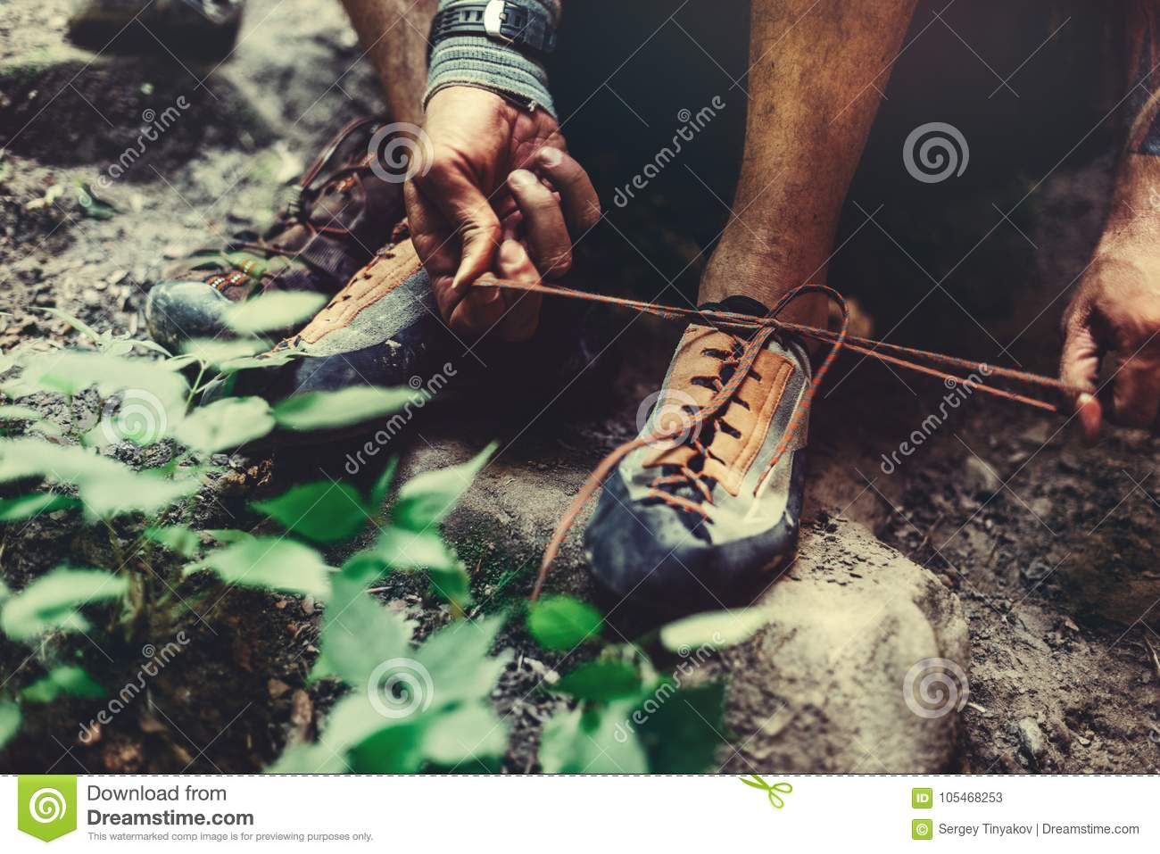 Man Dresses Climbing Shoes For Climbing, close-up. Extreme Hobby Outdoor Activity Concept