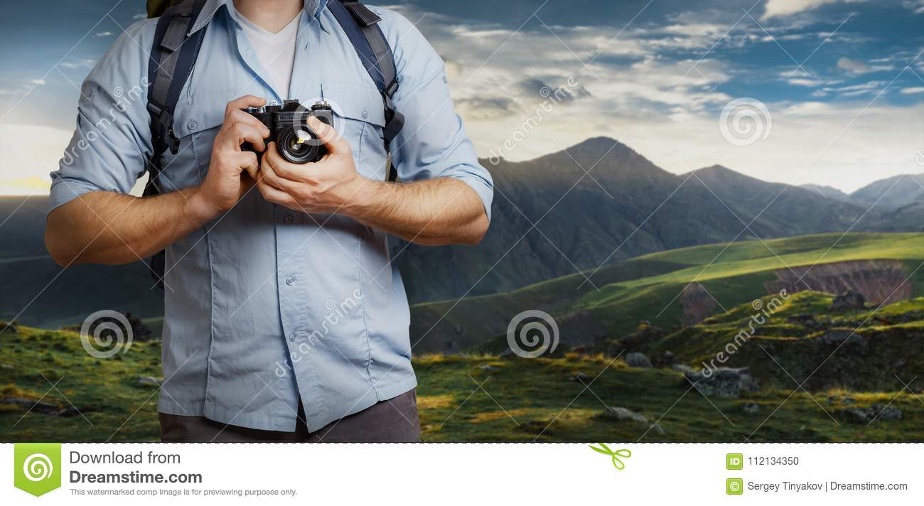 Unrecognizable Man Traveler Blogger Man With Backpack And Film Camera Near Mountains. Hiking Tourism Journey Concept