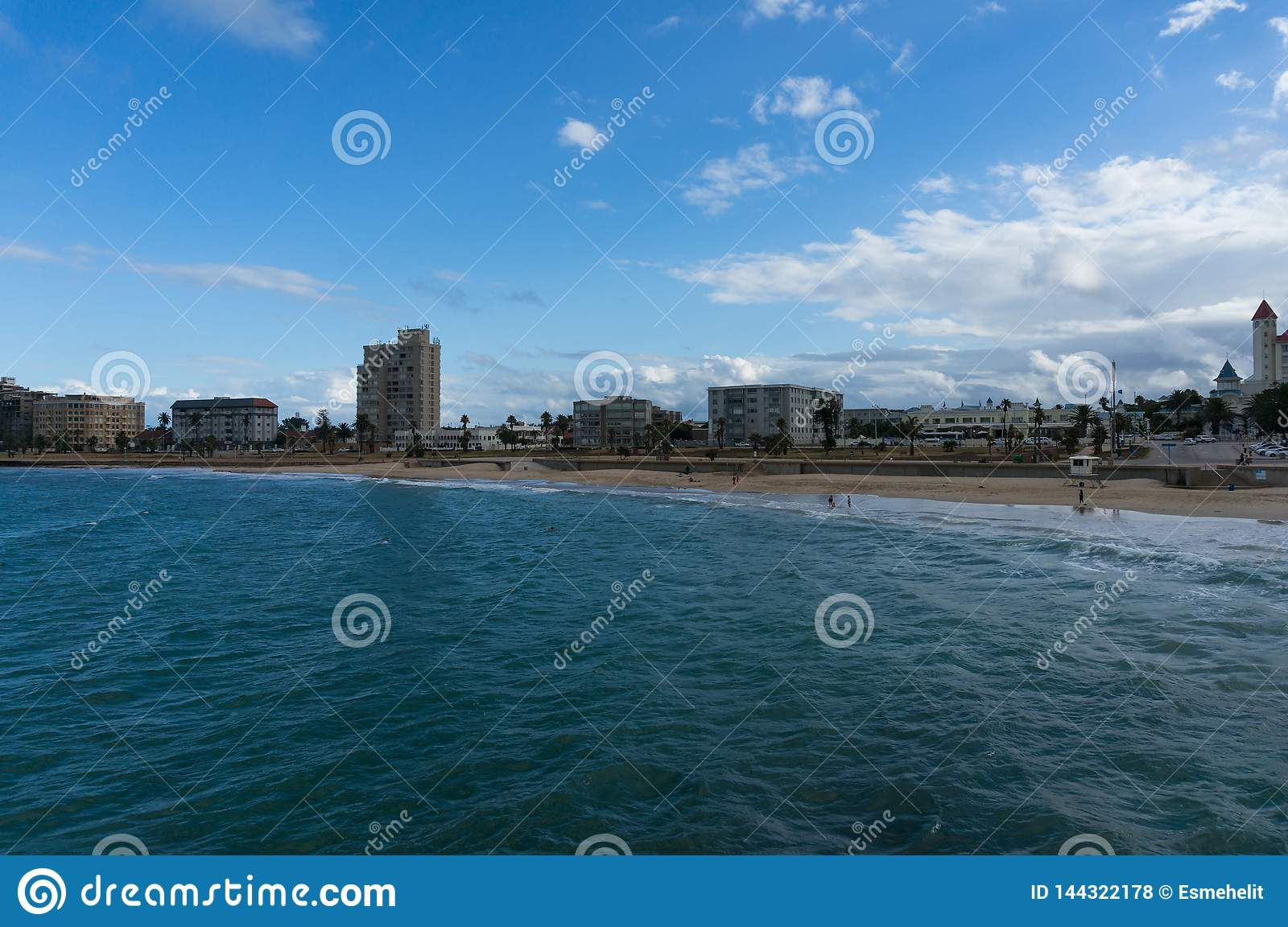 Unrecognizable people relaxing on the beach at Port Elizabeth, South Africa