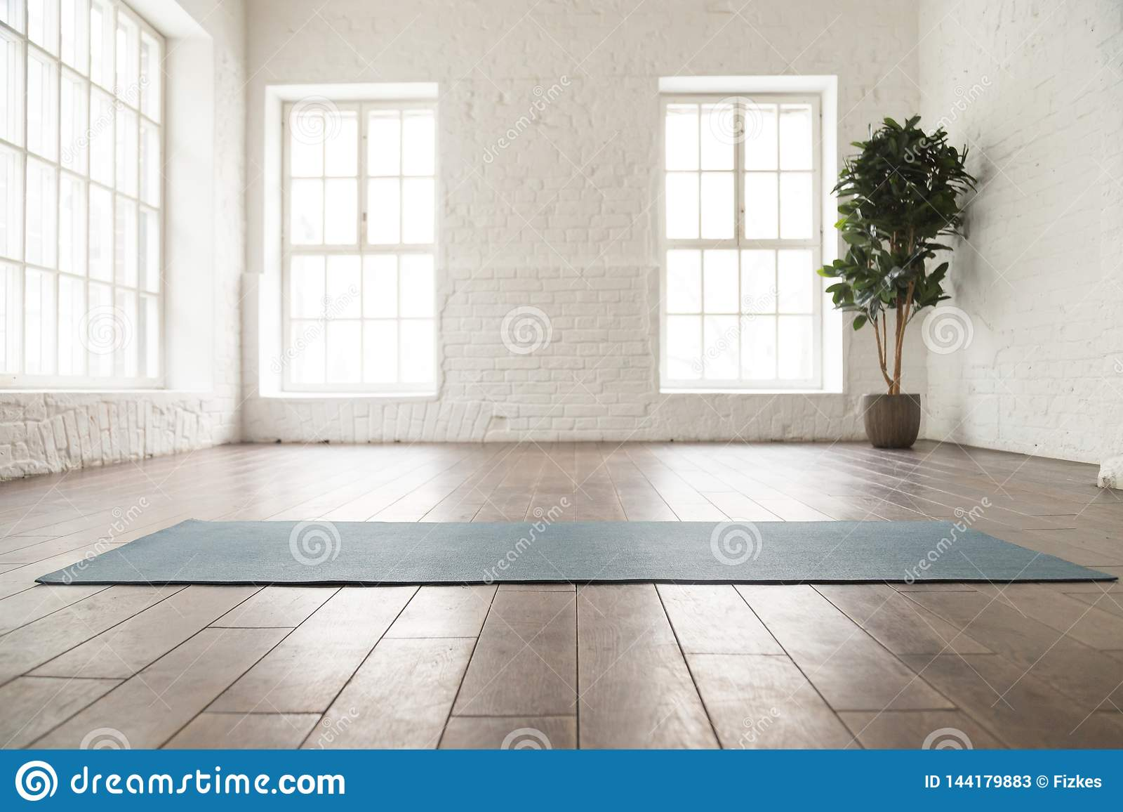 Unrolled Yoga Mat On Wooden Floor In Yoga Studio Stock Image Image Of Life Club 144179883