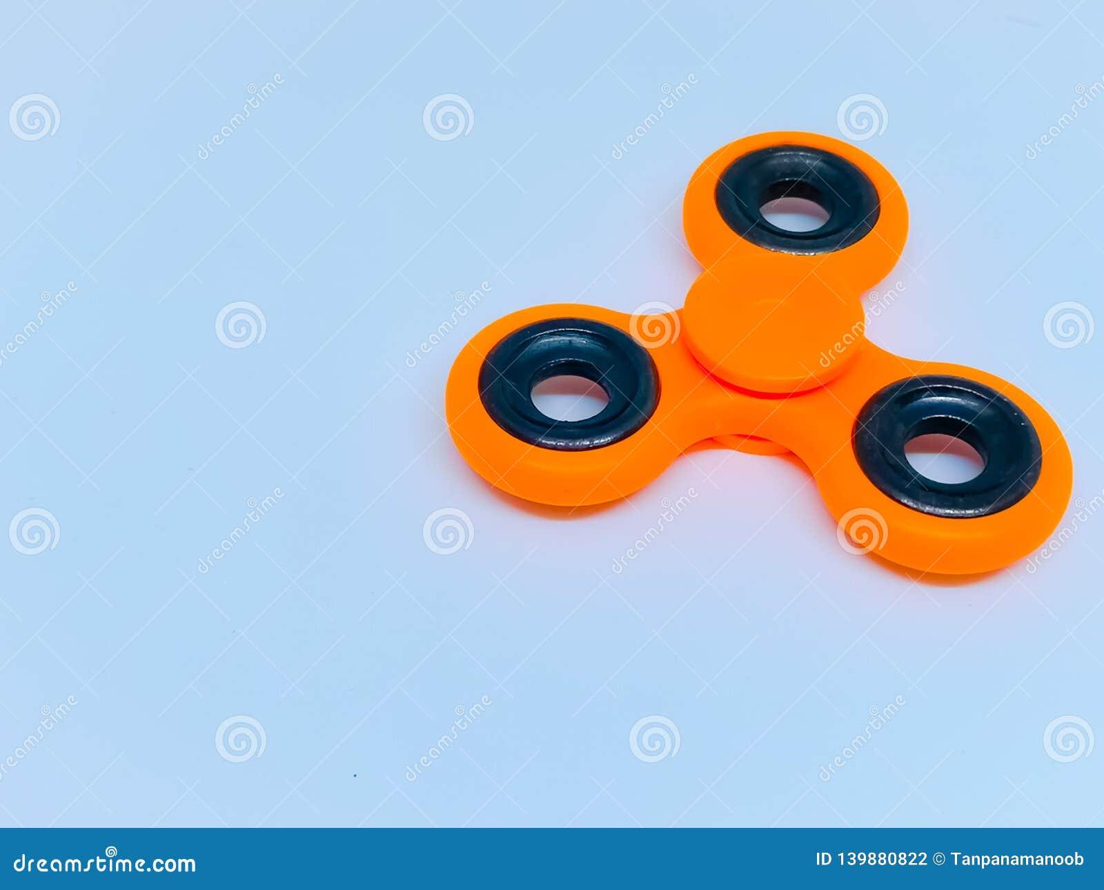 Unruhefinger-Spinnerdruck, Angstentlastungsspielzeug mit Hintergrund