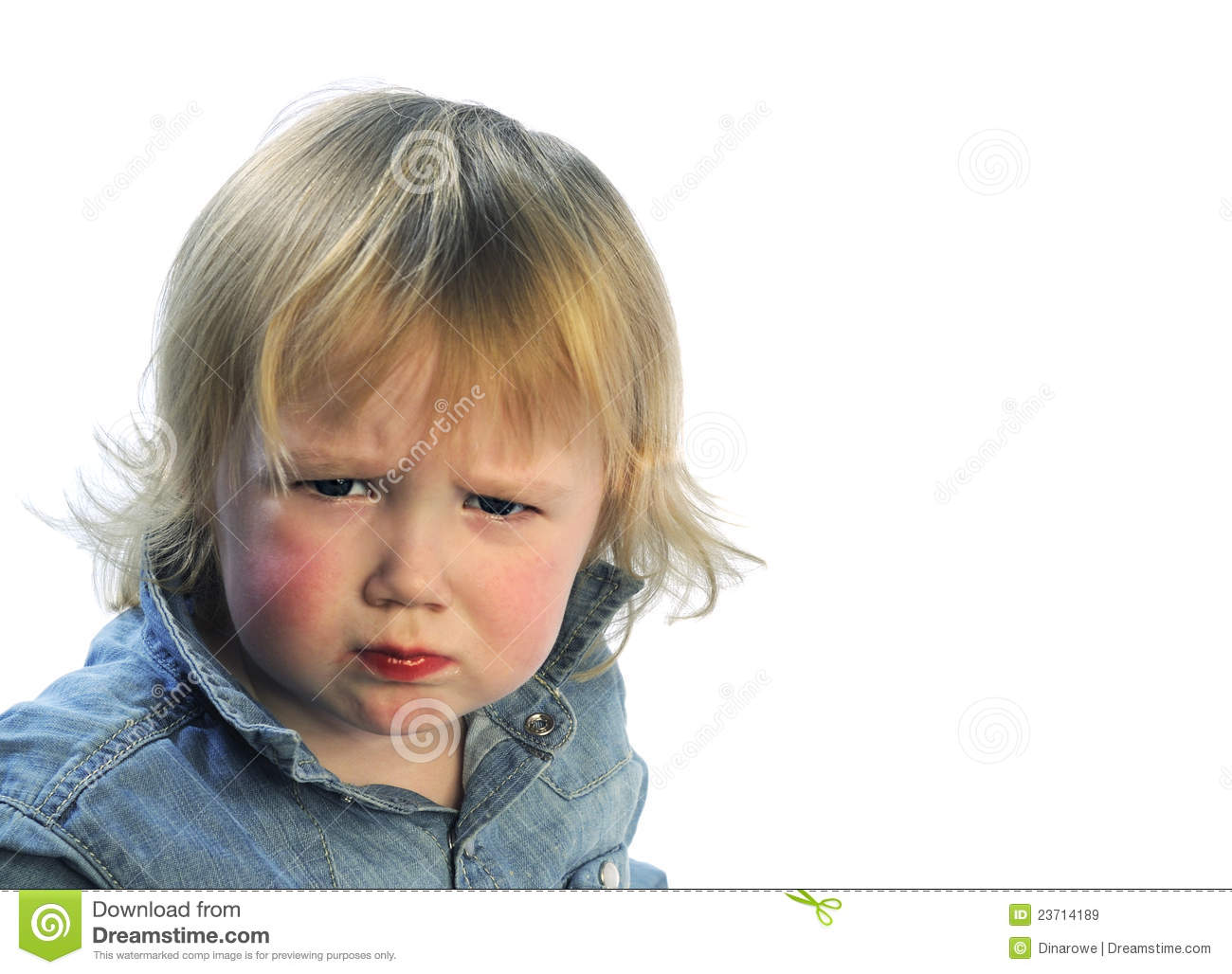 Portrait of unsatisfied toddler on white background.