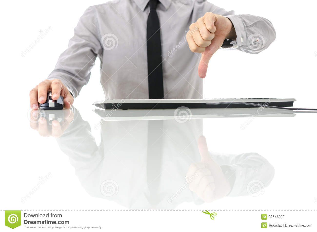white office desk working on computer and showing thumbs down sign