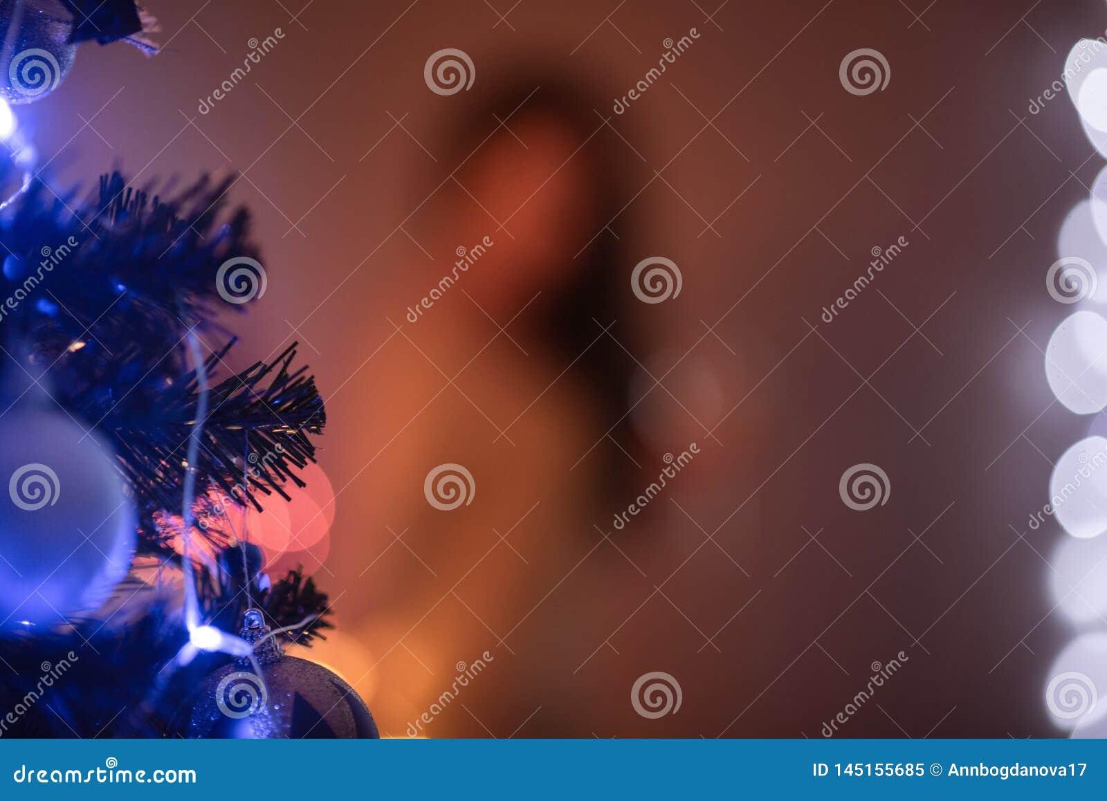 Unscharfer Weihnachtshintergrund für eine Aufschrift