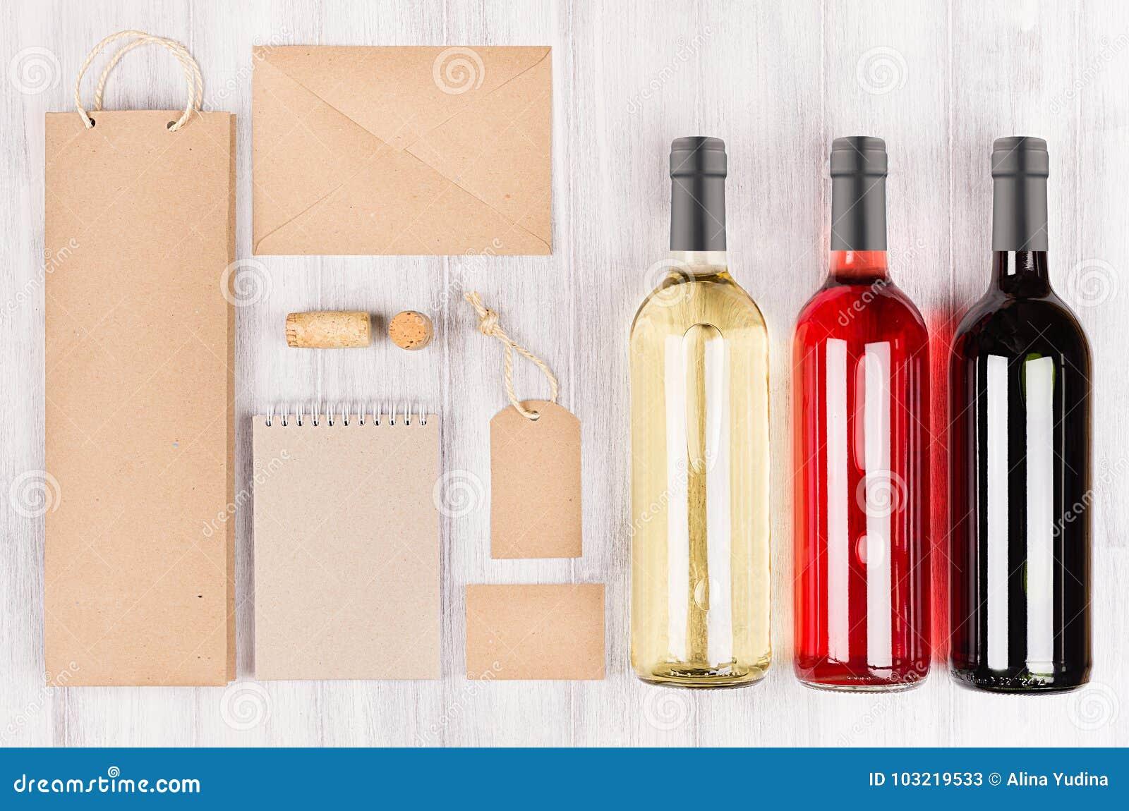 Unternehmensidentitä5sschablone für Weinindustrie, leere braune Kraftpapier-Verpackung, Briefpapier, Waren stellte mit Flaschen v
