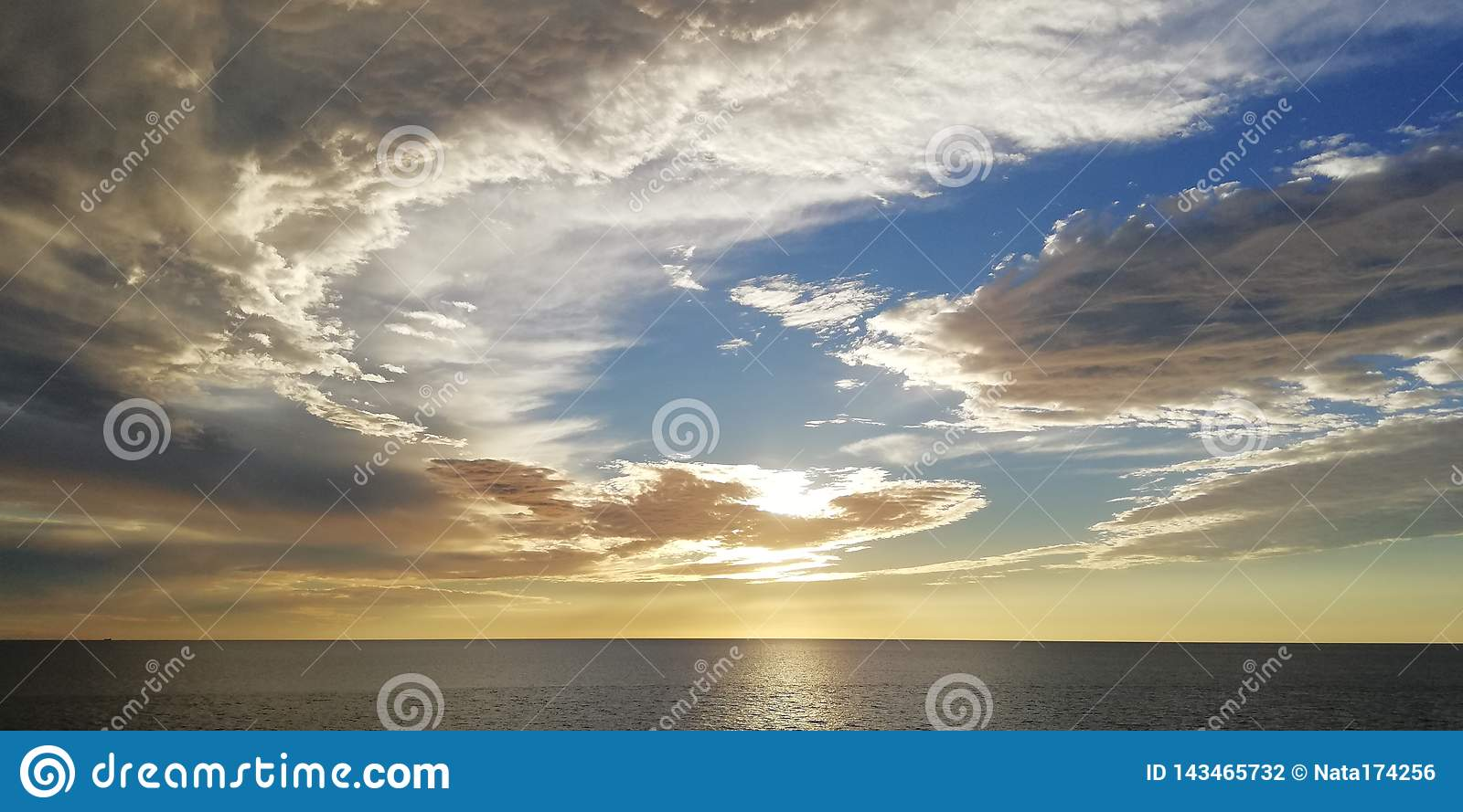 Seascape. Unusual clouds at sunset