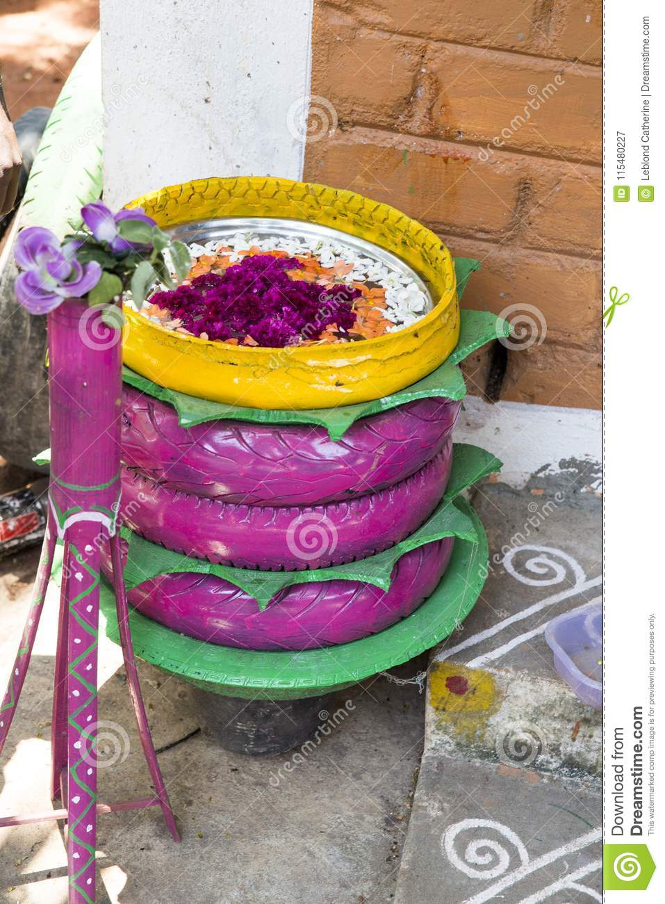 Unusual Flower Bed In The Garden. A Flower Bed Out Of Old Car Tires on tire art, tire landscaping, tire jewelry, tire fences, tire ponds, tire walls, tire water features, tire concrete, tire trees, spring designs, roof garden designs, tube garden designs, tire furniture,