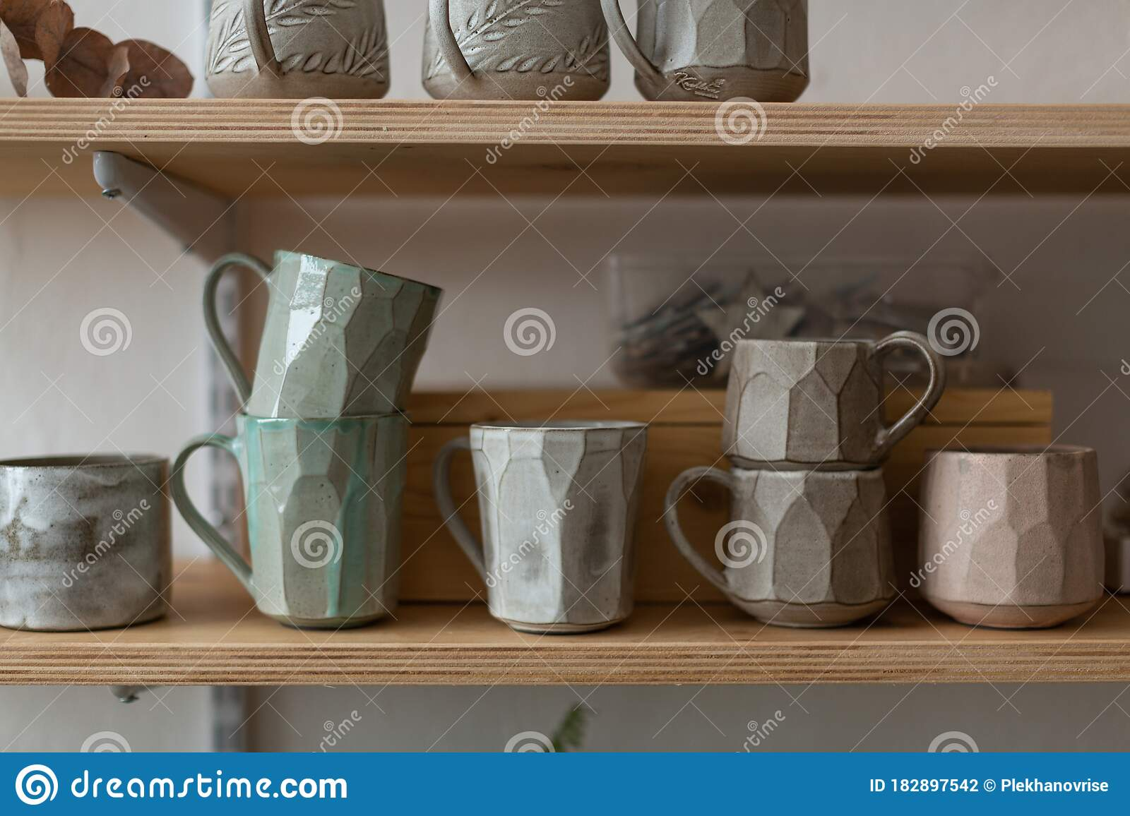 Unusual Handmade Ceramic Mugs On A Shelf In A Pottery Workshop Stock Photo Image Of Individual Gray 182897542