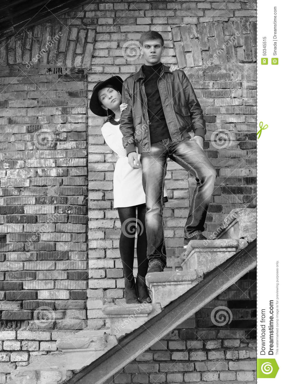 Unusual young pair of people love black and white stock image