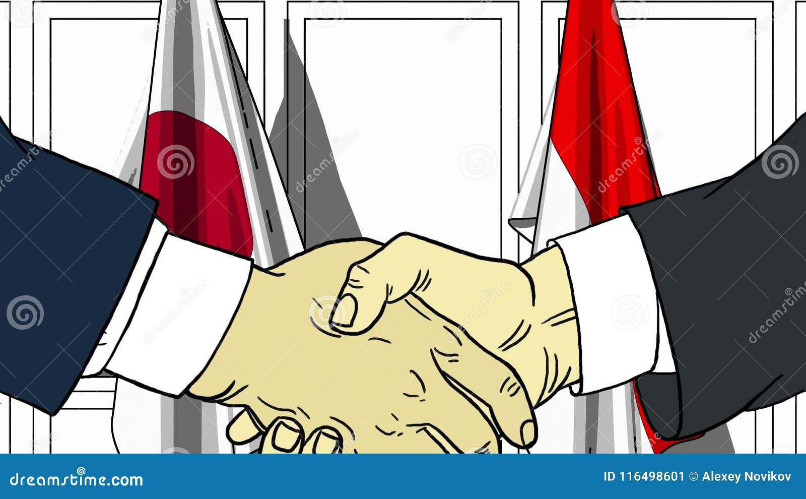 Uomini d affari o politici che stringono le mani contro le bandiere del Giappone e dell Indonesia Riunione o fumetto relativo di