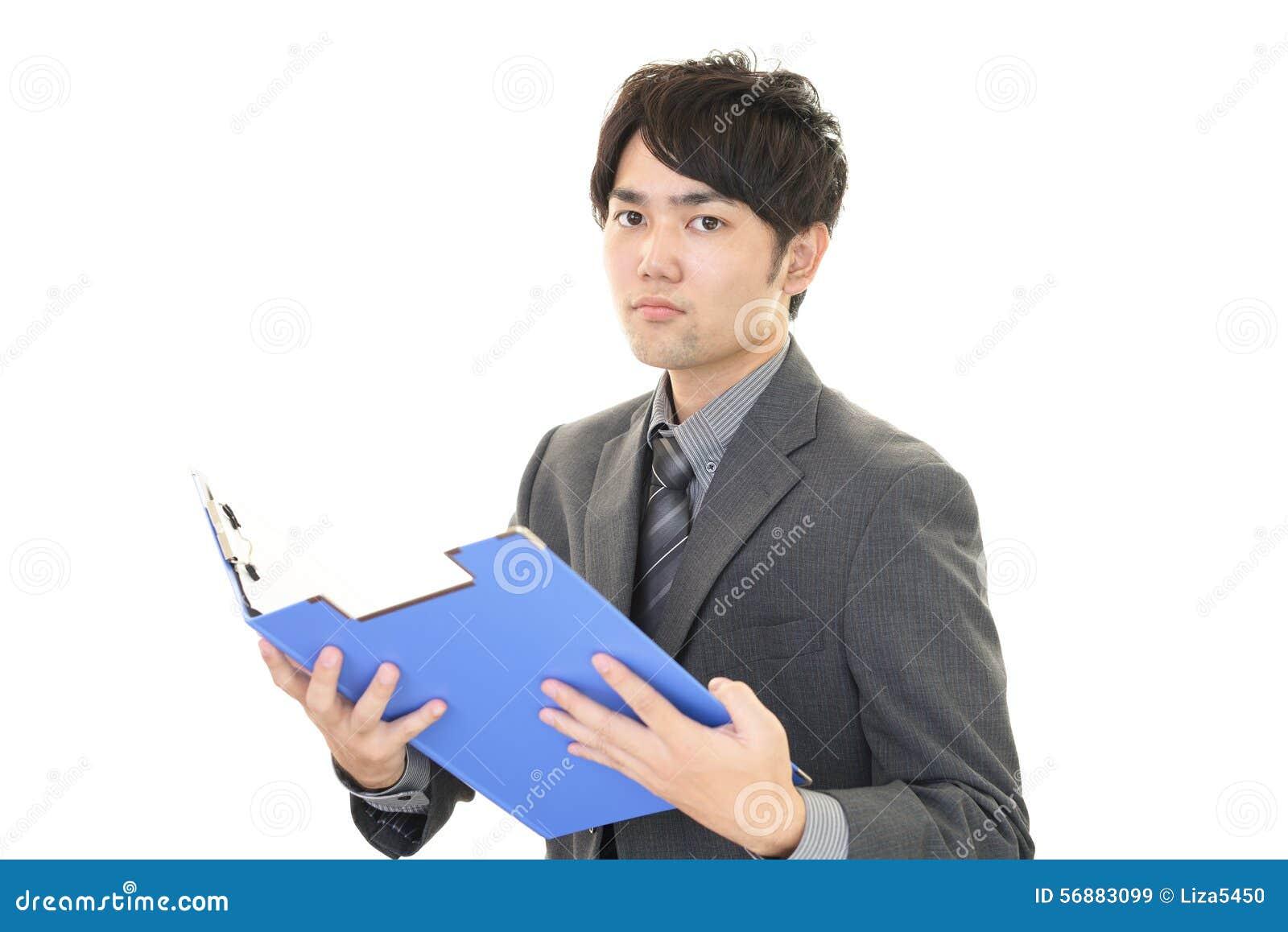 Uomo d affari asiatico sorridente