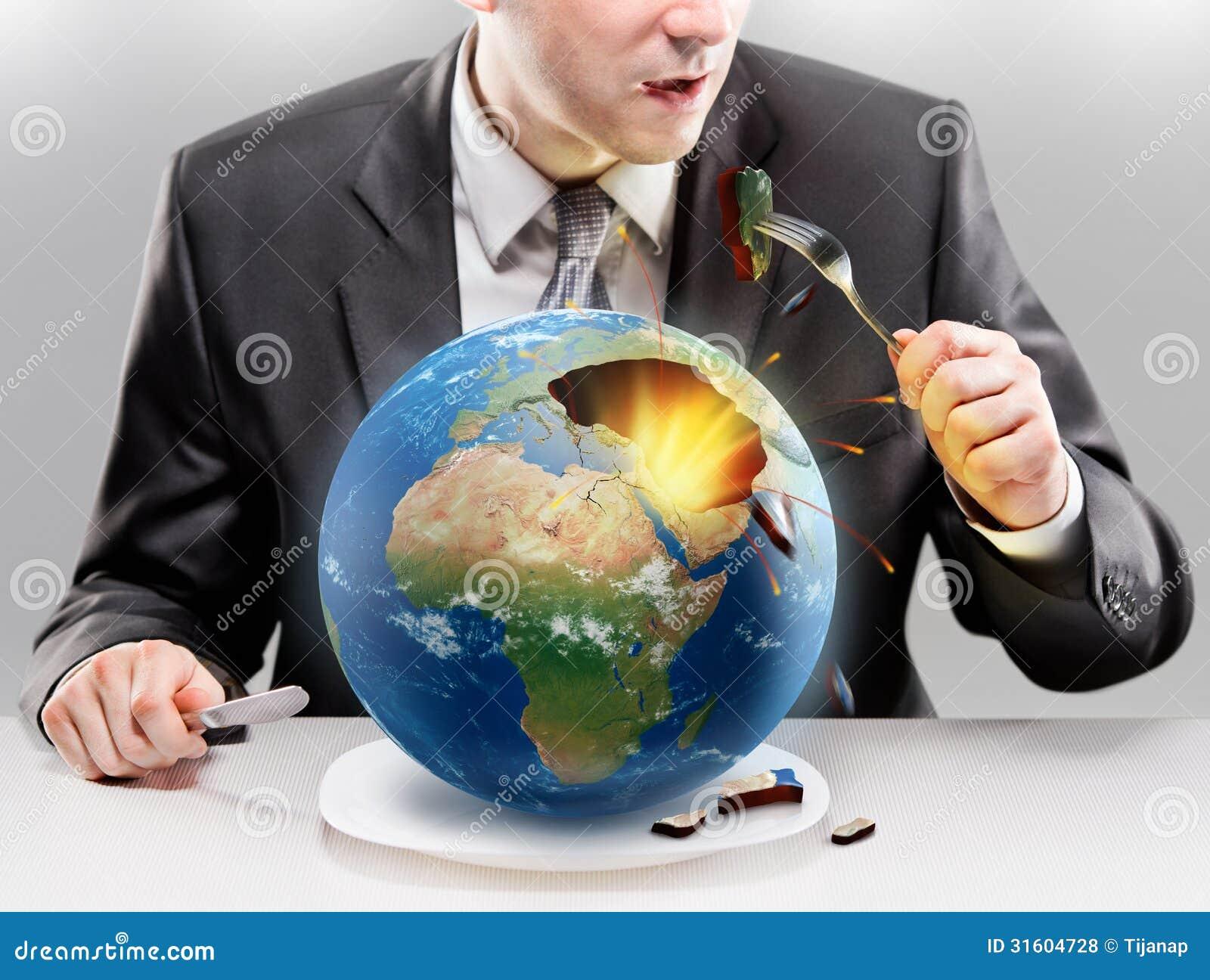 Uomo d affari avido che mangia pianeta Terra