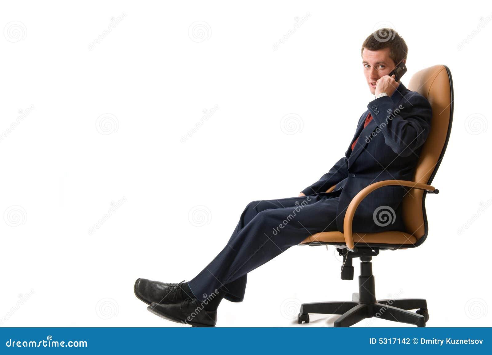 Download Uomo D'affari Che Si Siede Su Una Poltrona Fotografia Stock - Immagine di background, businessman: 5317142