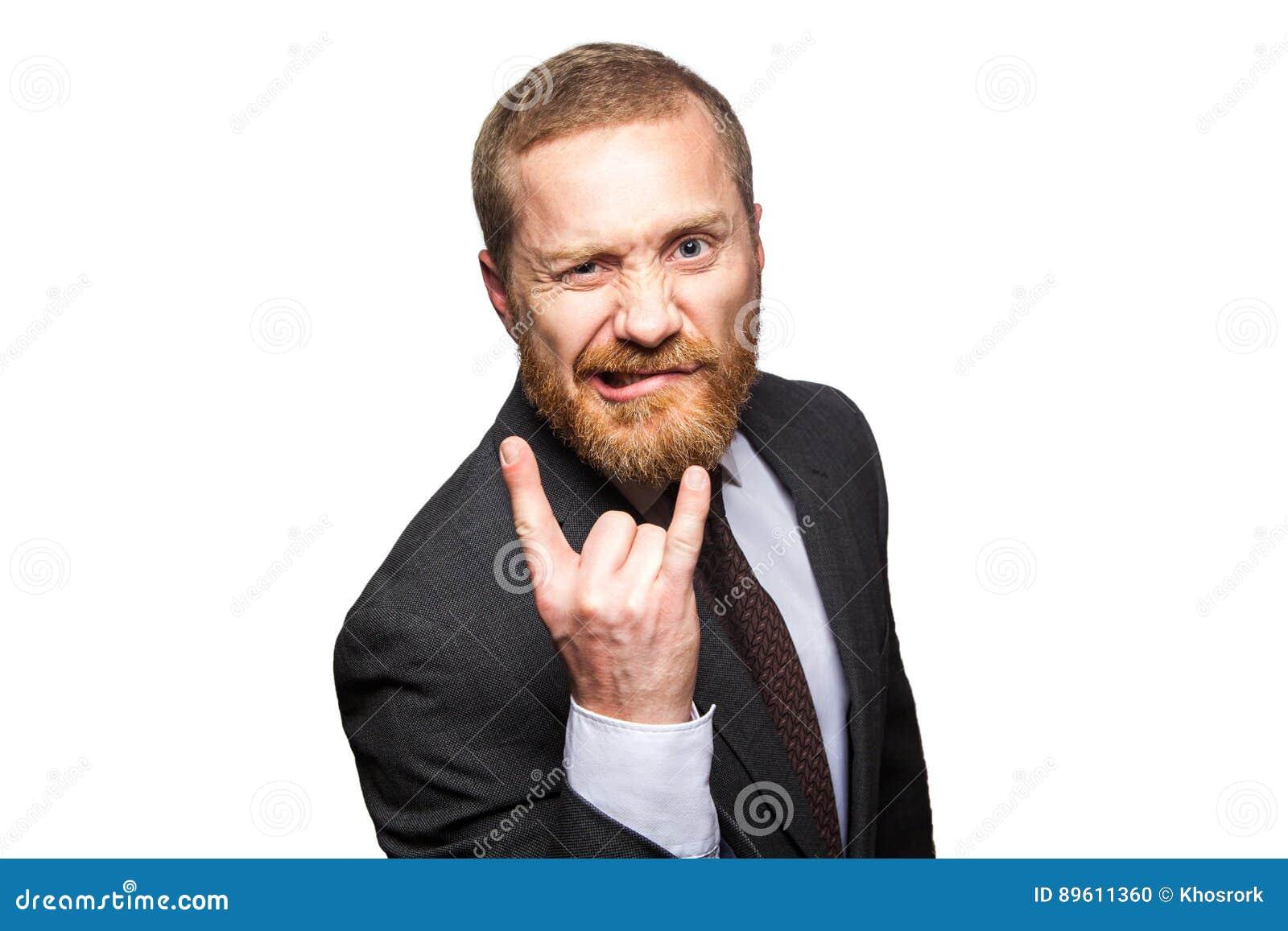 Uomo d affari divertente che fa corno gesture - il segno di rock-and-roll