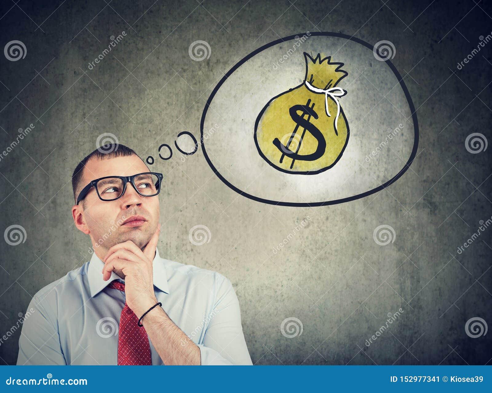Uomo di affari che sogna di un successo finanziario