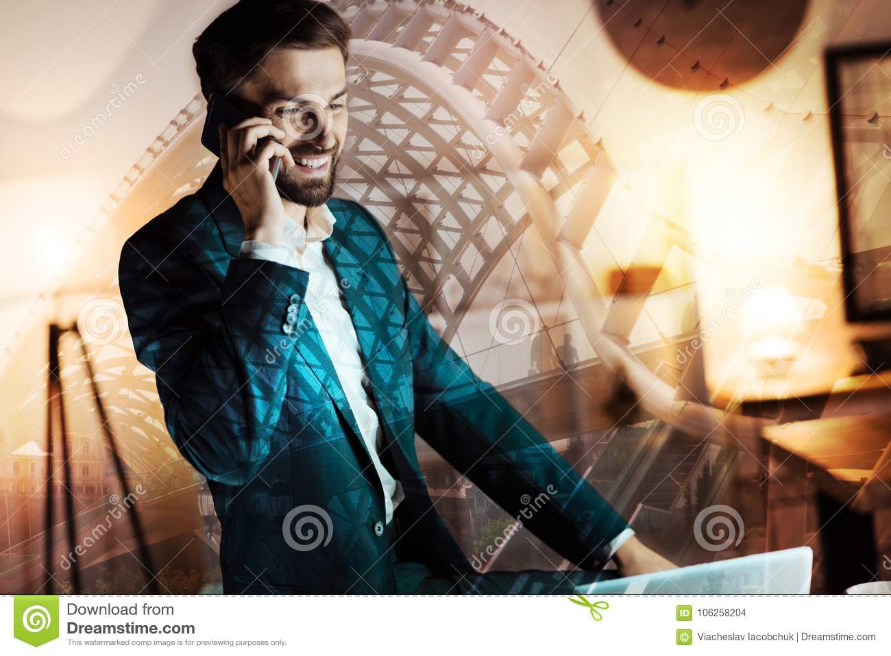 Upbeat Businessman Talking On The Phone And Smiling Stock Photo