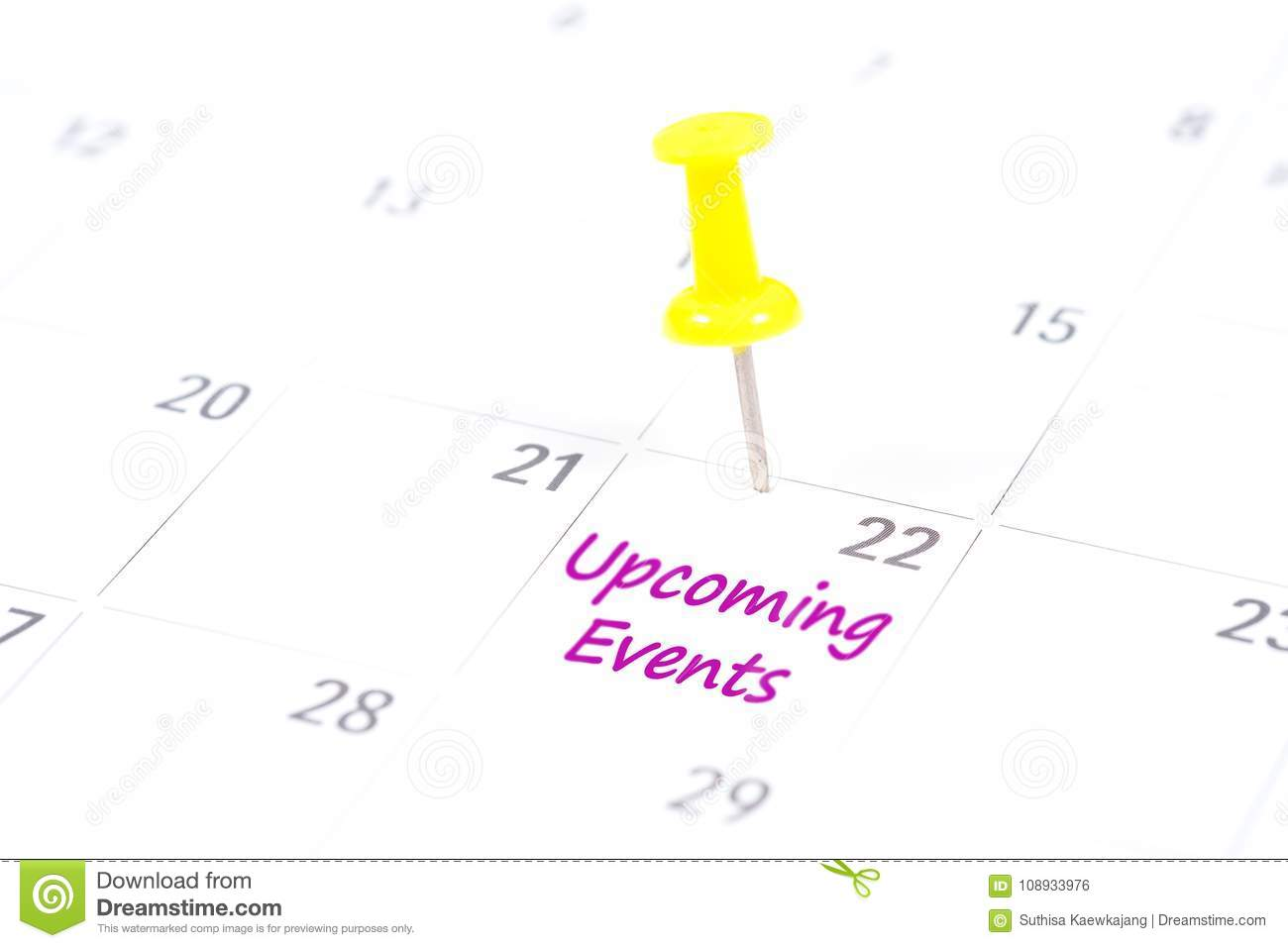 Upcoming Events written on a calendar with a yellow push pin to