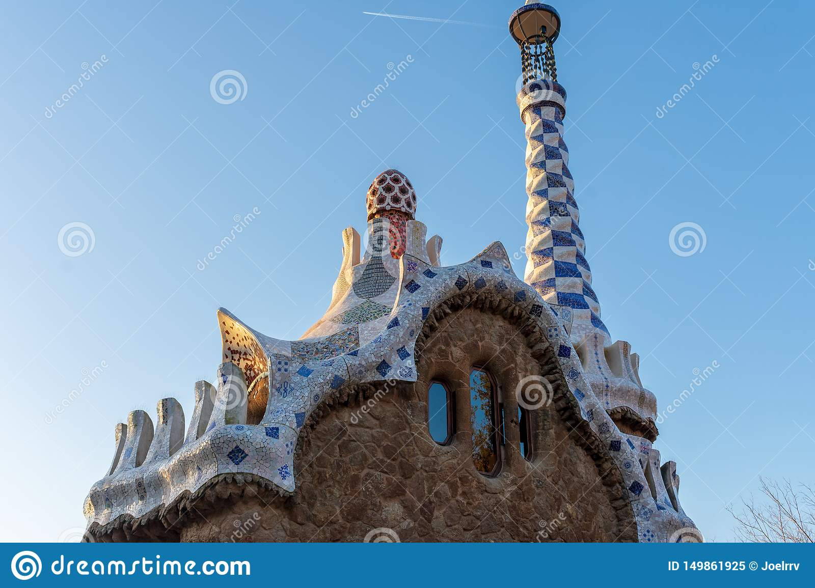 Upper view of Entry Pavillon at parc Guell in Barcelona at sunset