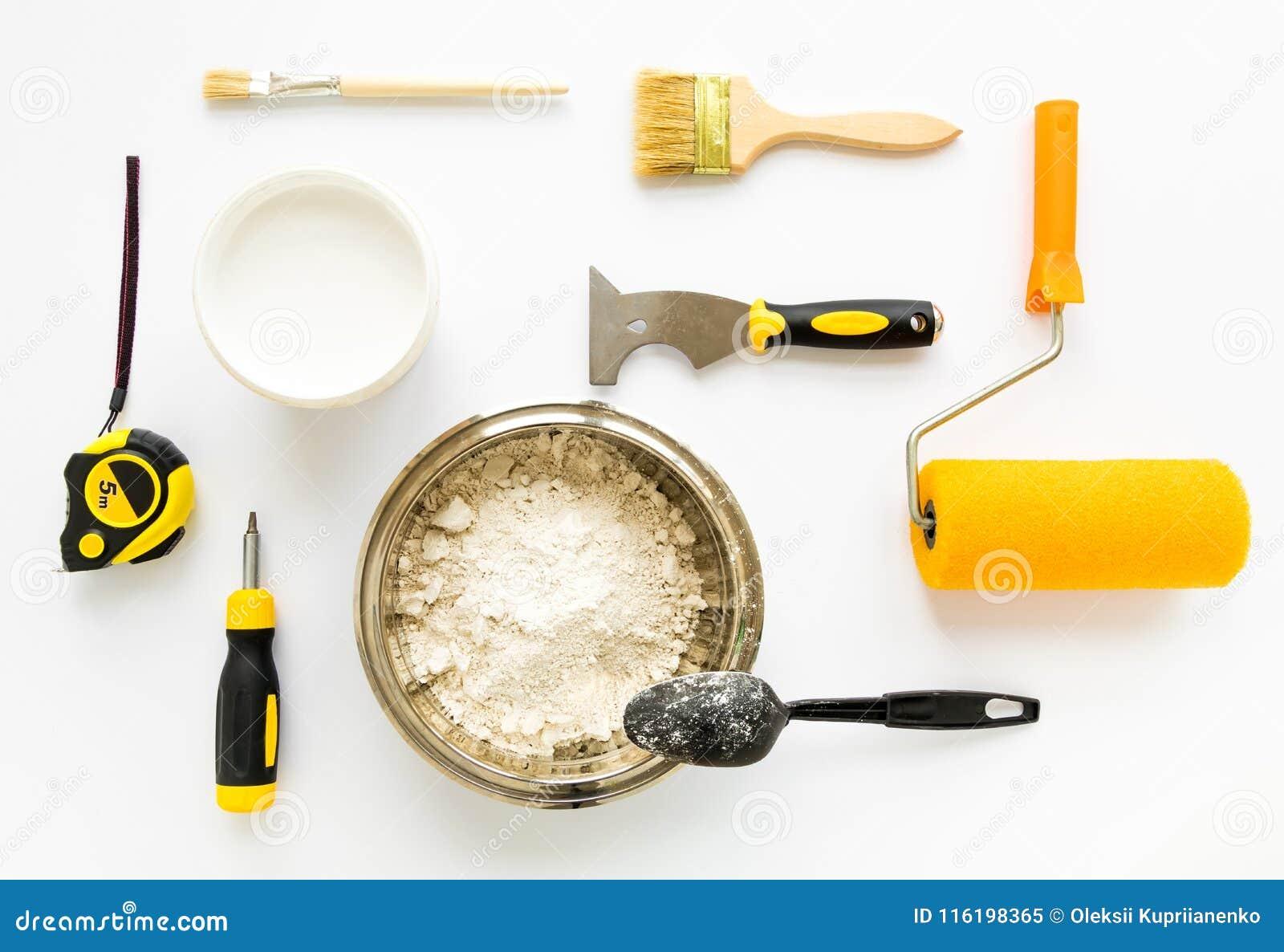 Uppsättning av husreparationen som konstruerar och målar utrustning på vit bakgrund Lekmanna- lägenhet