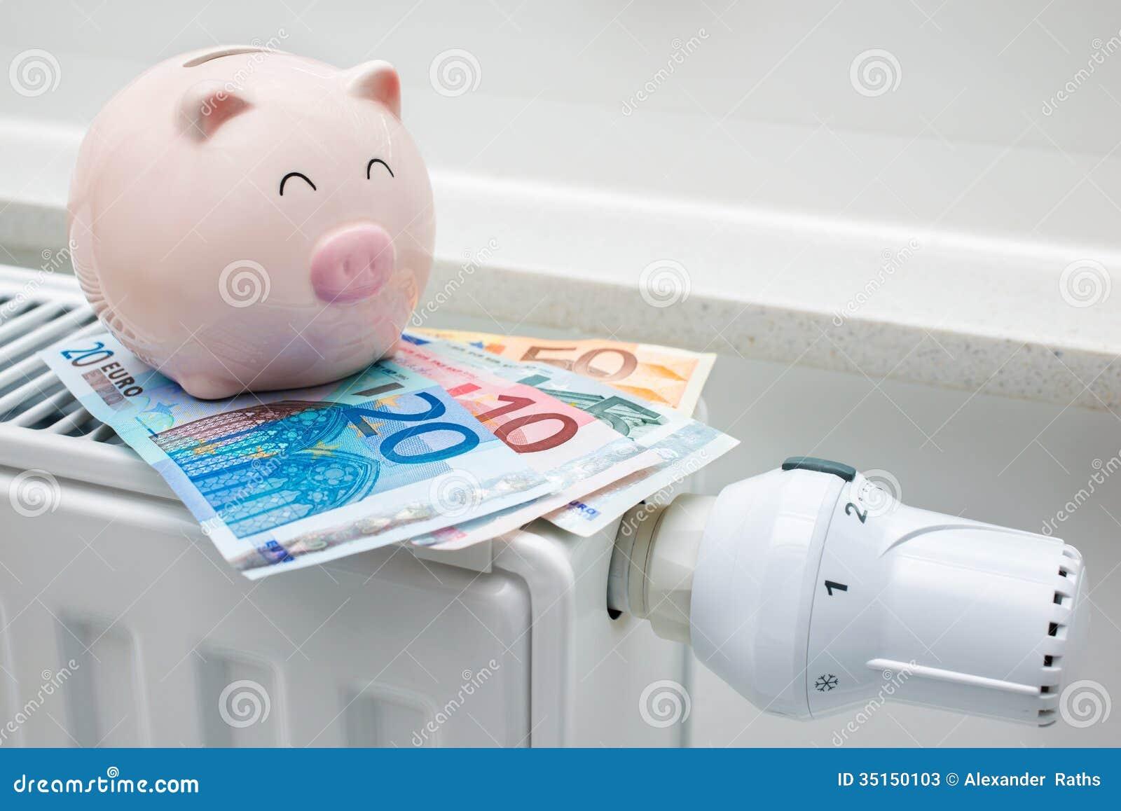 Uppvärmningtermostat med spargrisen och pengar