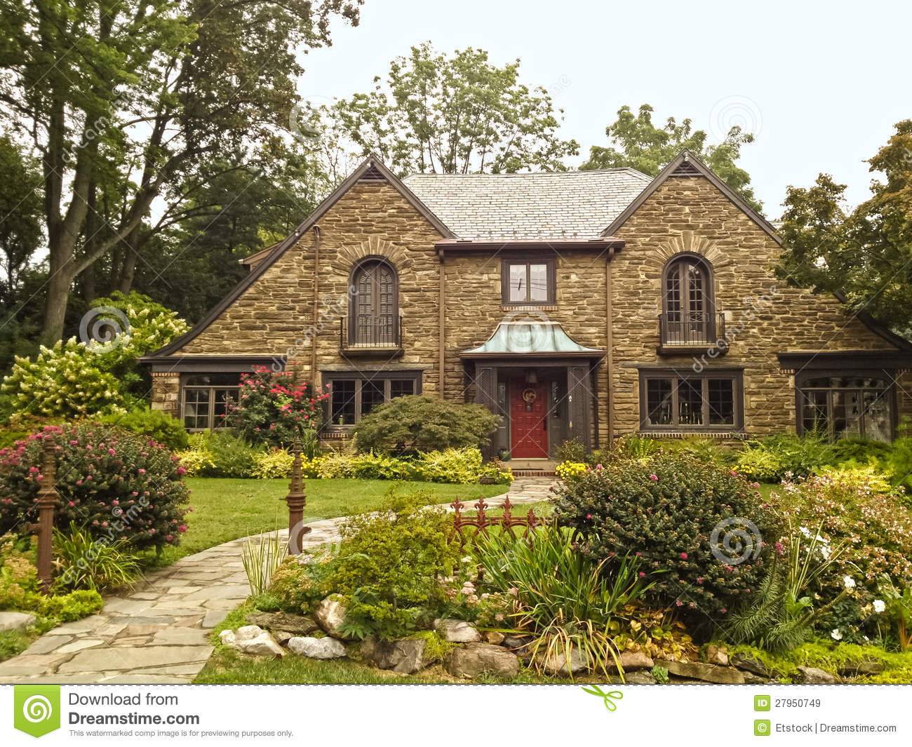 Upscale family home with beautiful landscaping stock image for What is family home
