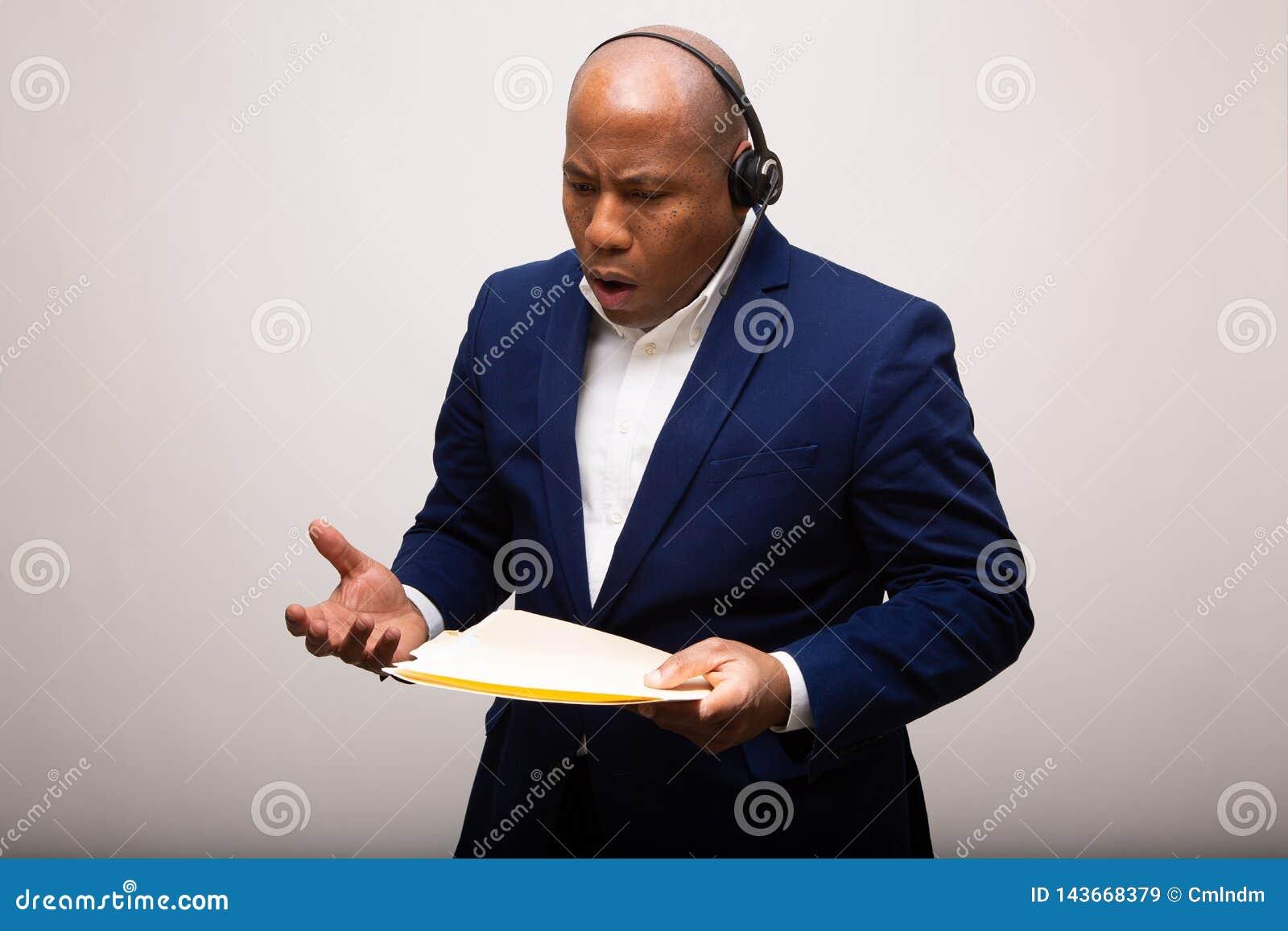 Upset African American Businessman Talks Through Headset