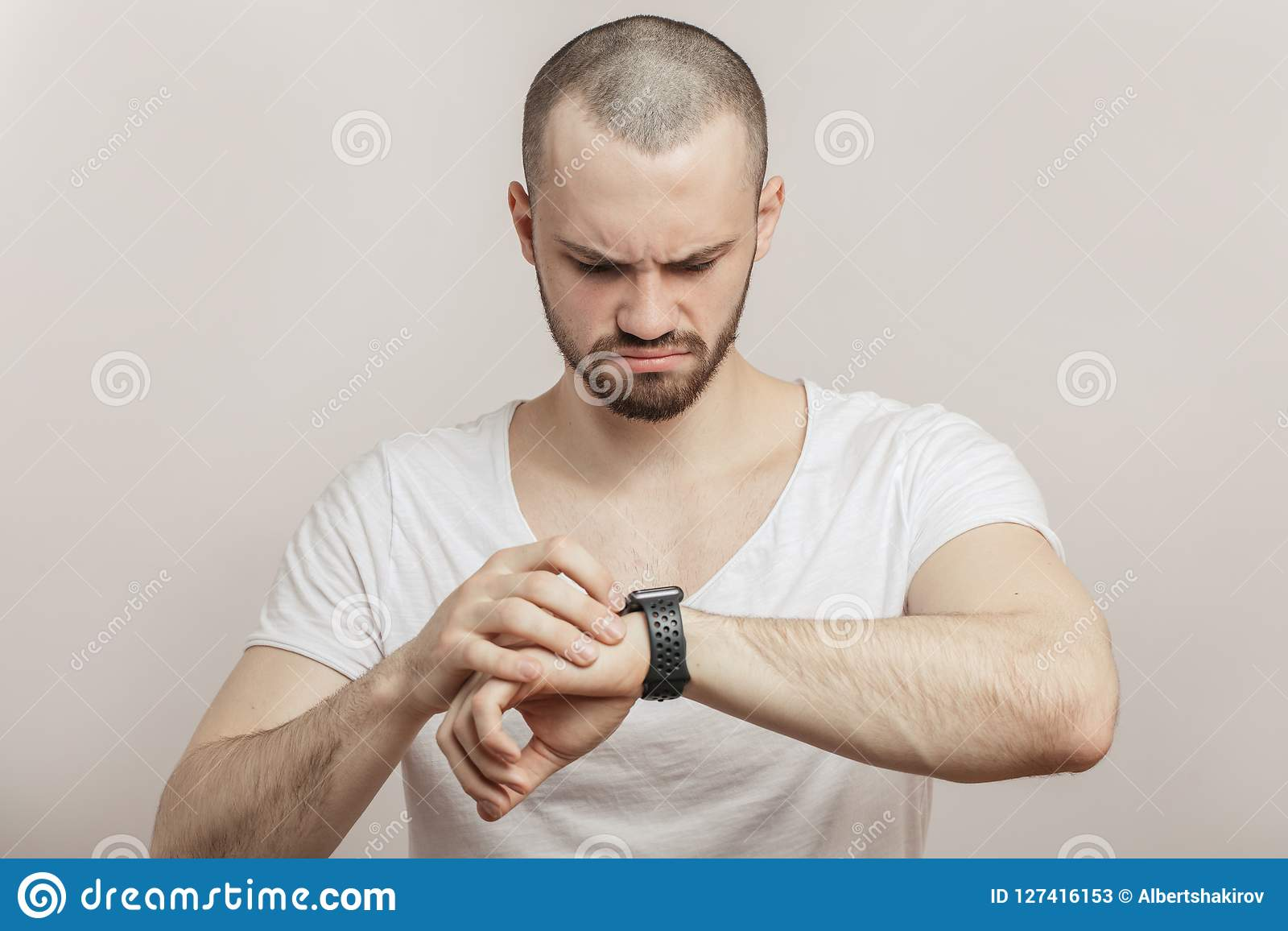Upset, angry athlete with heart rate monitor watch.