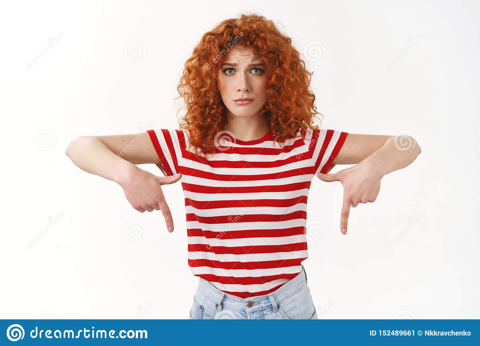 Upset cute silly redhead curly girlfriend complain pointing down frowning look camera disappointed missed promo cool