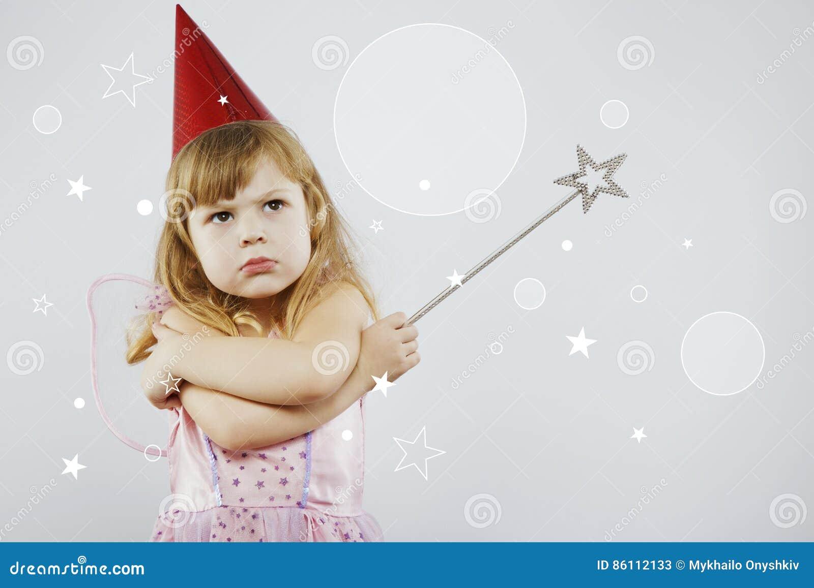 00087b61e Upset Girl Posing With Silver Magic Stick Stock Image - Image of ...