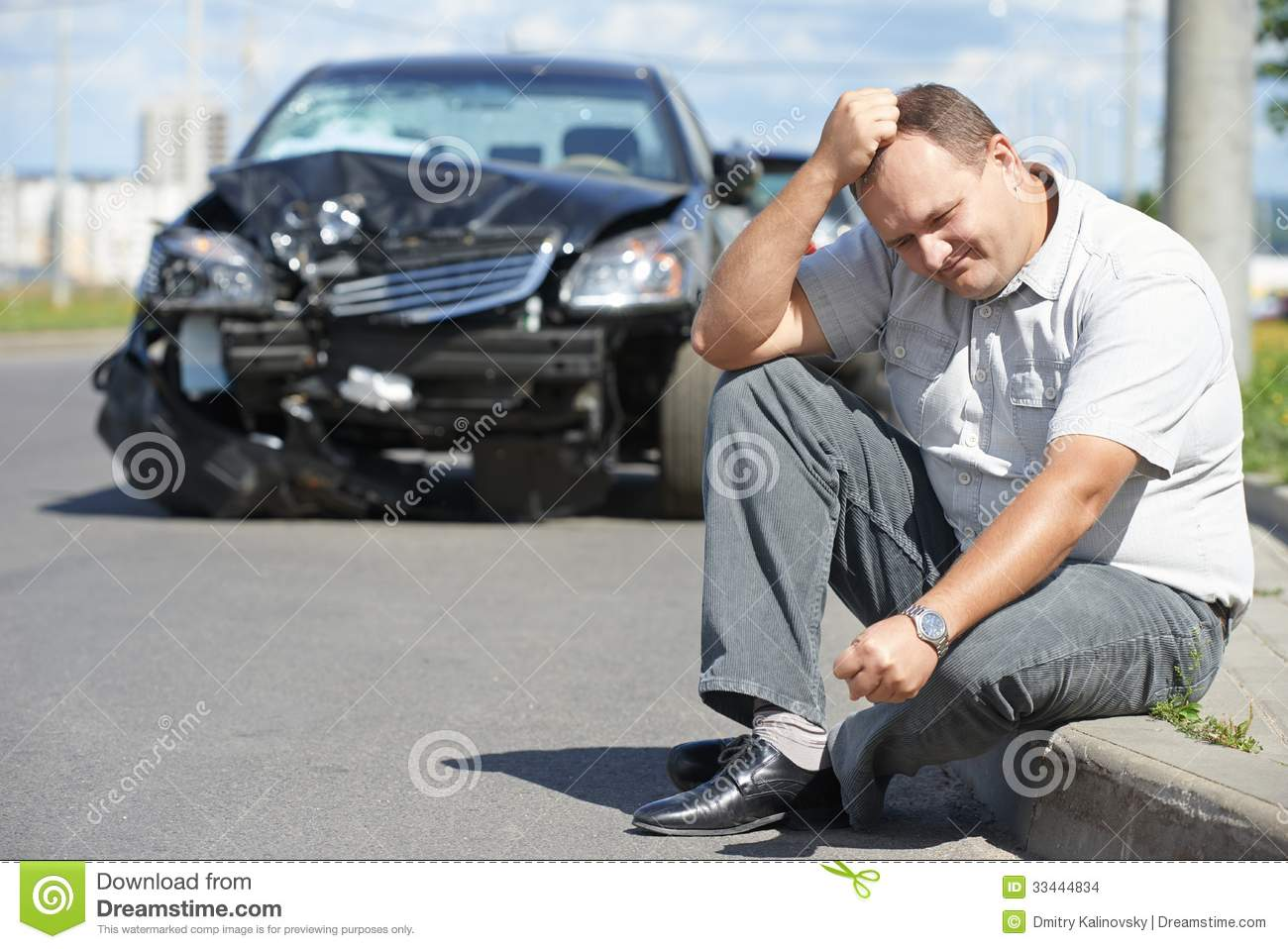 ... man in front of automobile crash car collision accident in city road