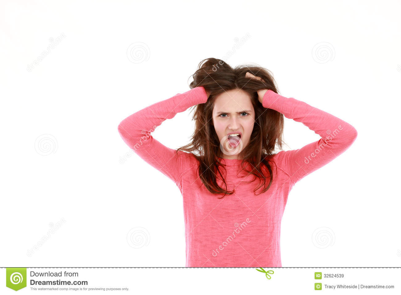 Shocked teen girl with hands in hair looking at camera isolated on ...