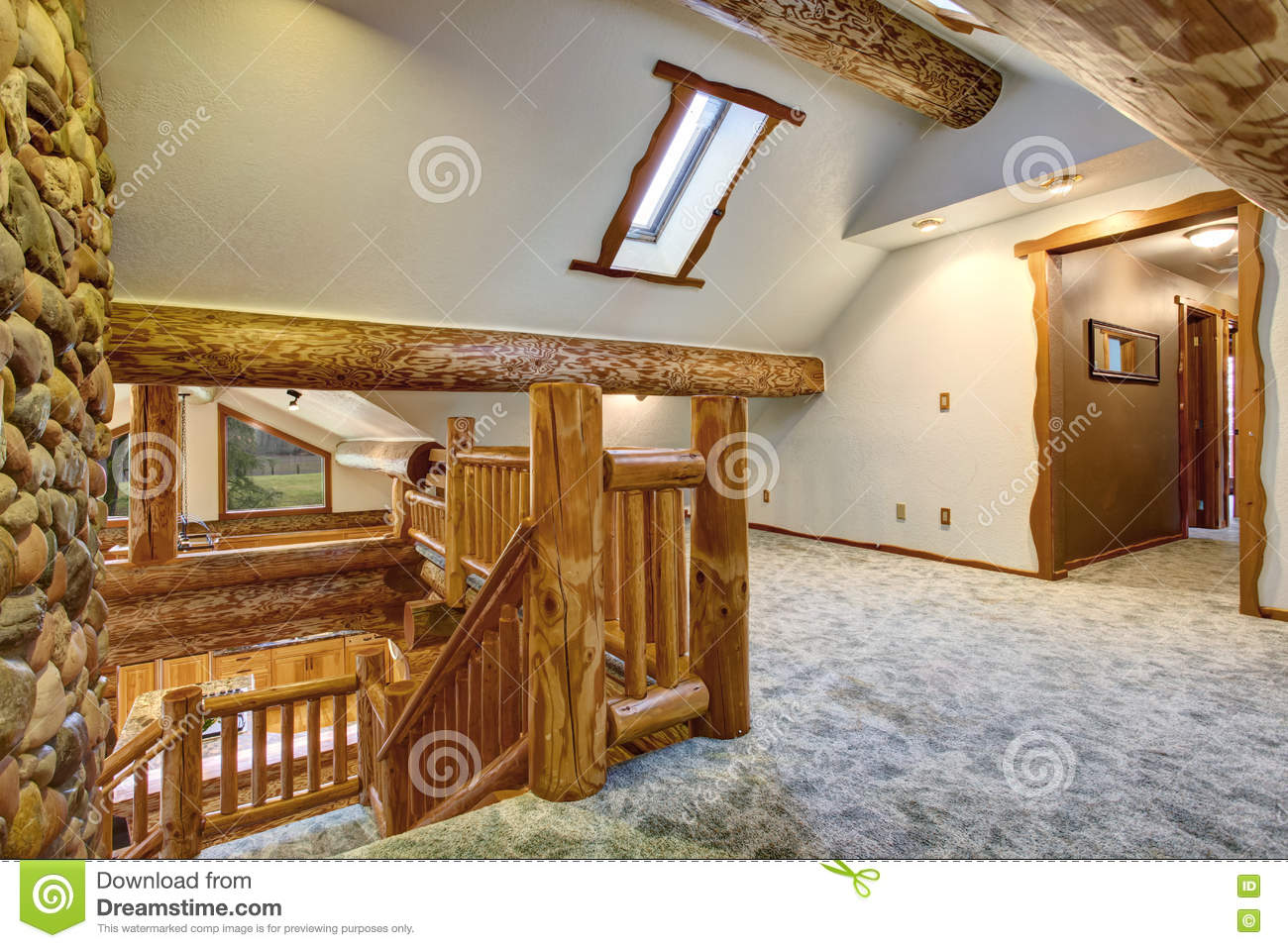 Upstairs Empty Room With Carpet Floor And Pitched Ceiling Stock