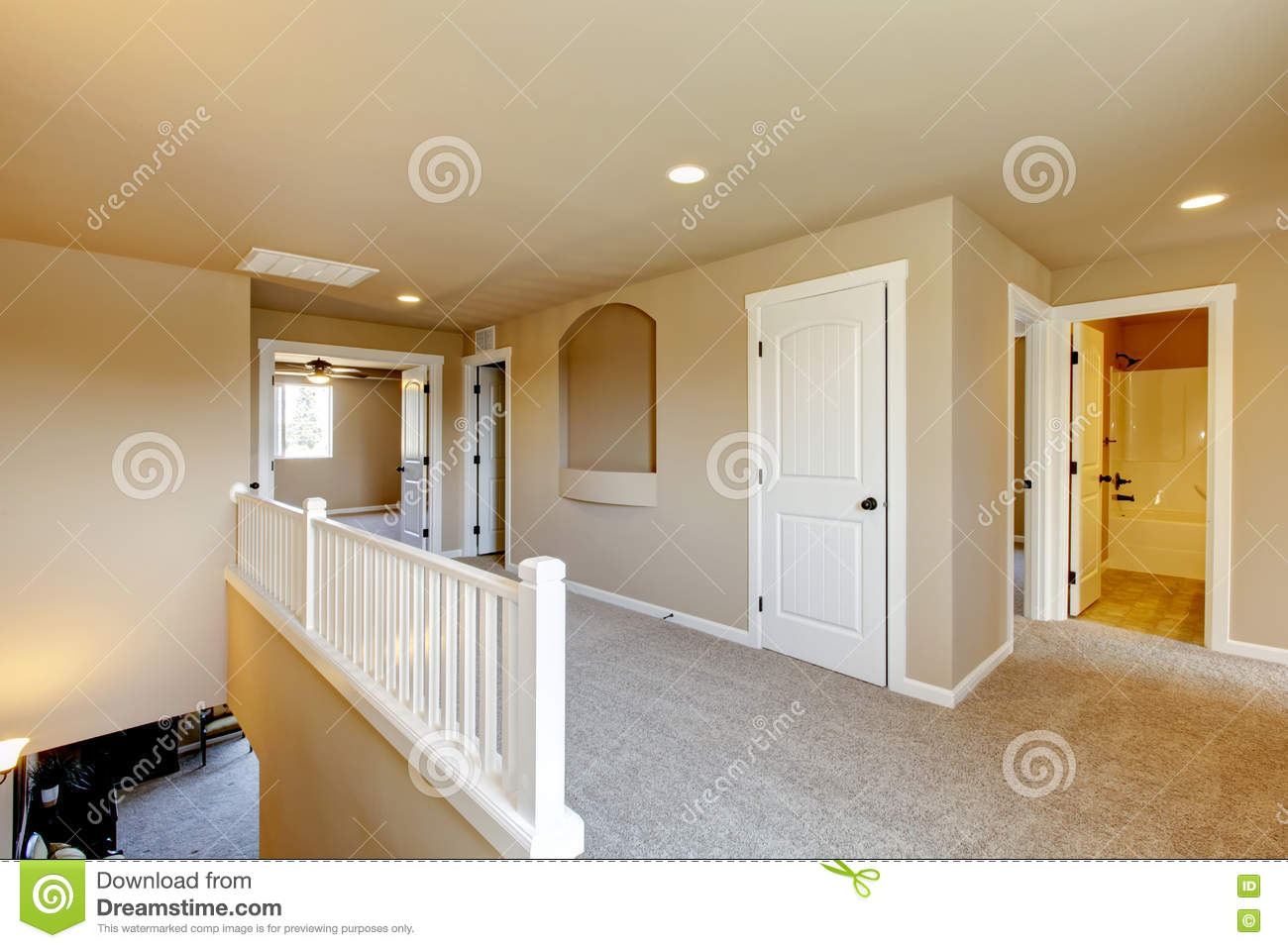Upstairs Hallway In Big House With Beige Interior Paint